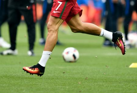 Moths fly around as Portugal's Cristiano Ronaldo runs during warm up before the Euro 2016 final soccer match between Portugal and France at the Stade de France in Saint-Denis, north of Paris, Sunday, July 10, 2016. (AP Photo/Martin Meissner)