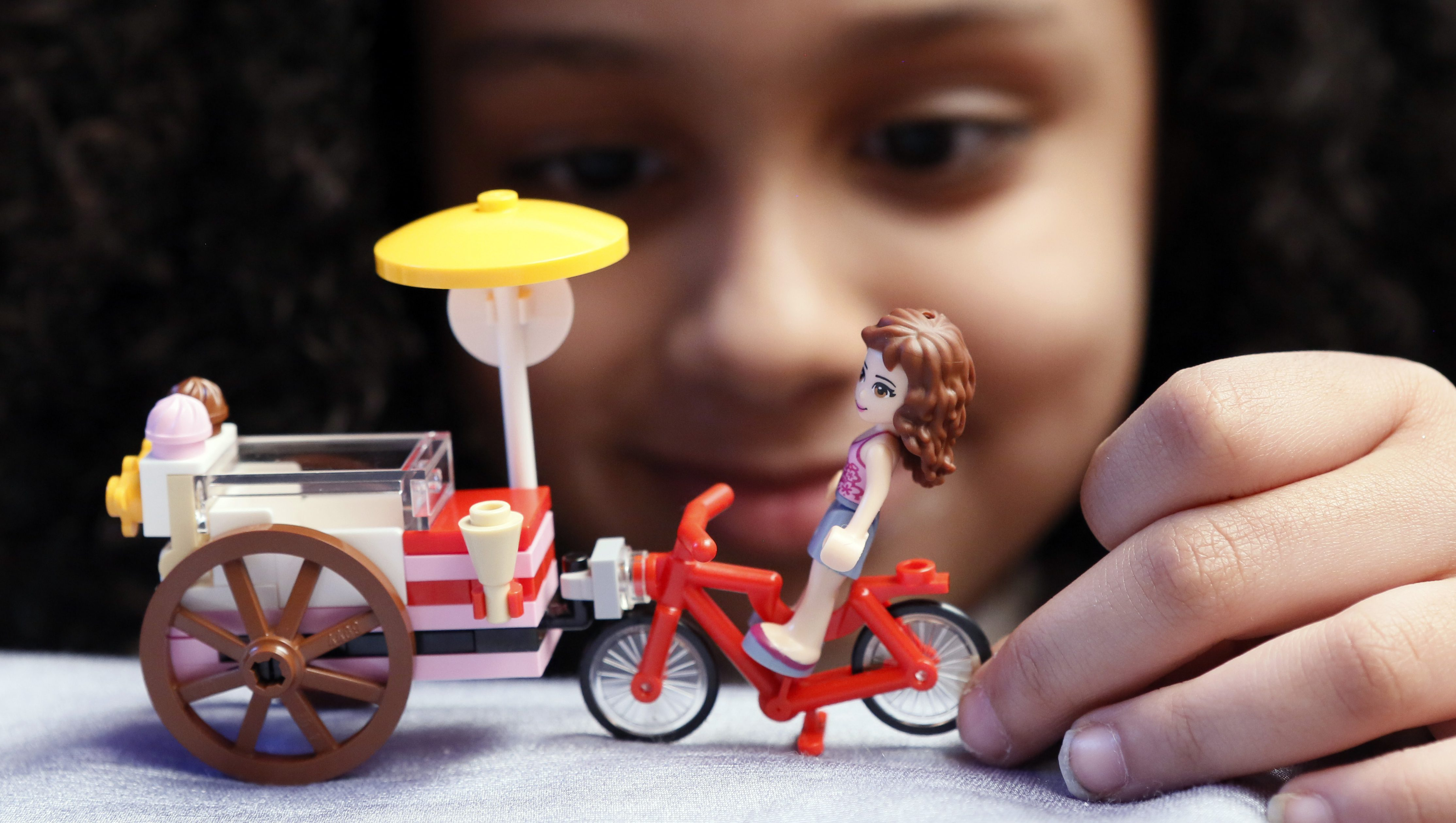 IMAGE DISTRIBUTED FOR MERLIN ENTERTAINMENT/LEGOLAND RESORTS - Gabriella Gudiel, 7, of Astoria, Queens, plays with a LEGO Friends set that she built at the LEGOLAND Florida Resort press event at the Grand Hyatt, on Tuesday, March 24, 2015 in New York. The second LEGOLAND Hotel in North America opens in Winter Haven, FL., on May 15, 2015.  (Photo by Stuart Ramson/Invision for Merlin Entertainments/LEGOLAND Resorts/AP Images)