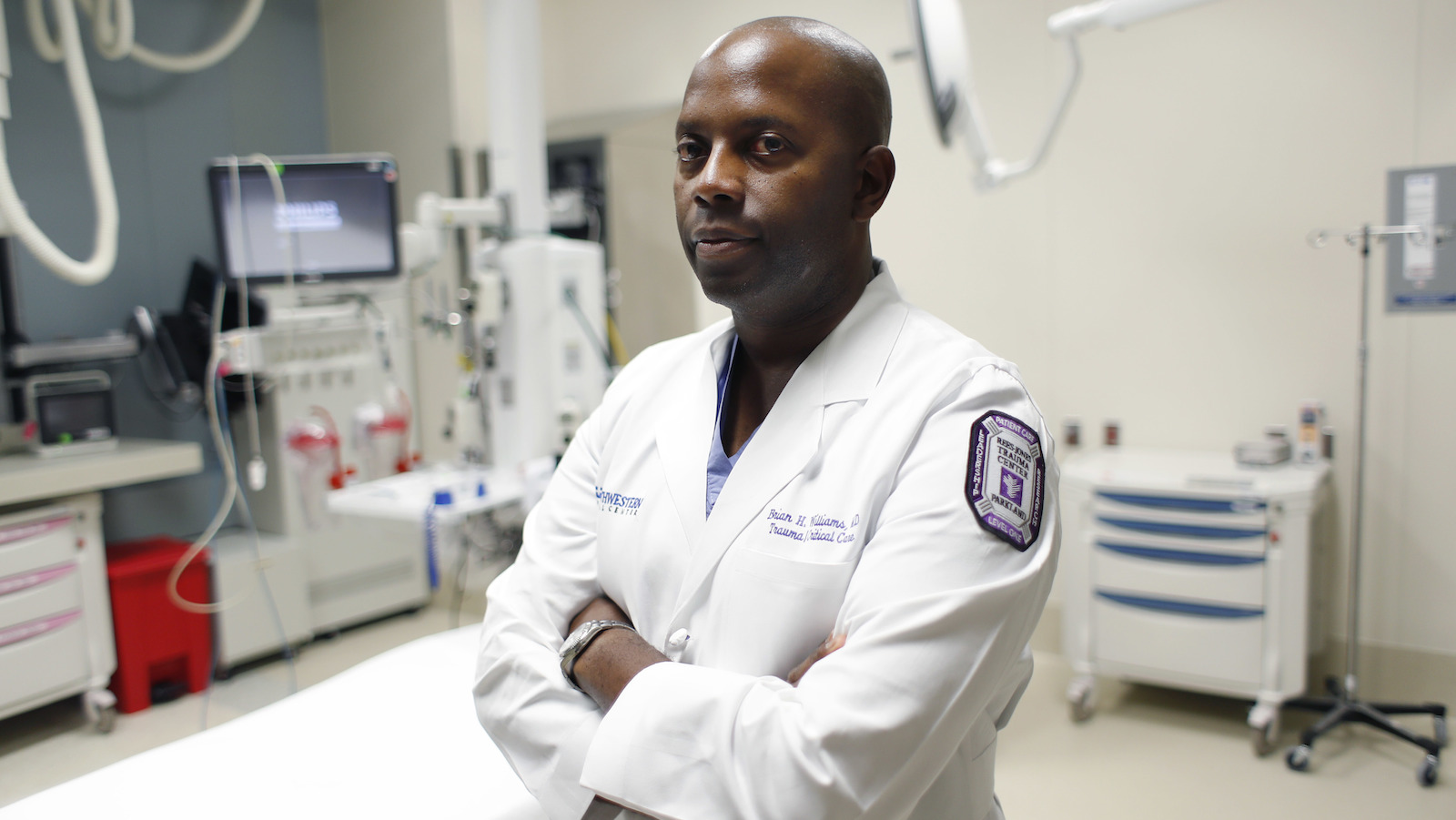 Dr. Brian H. Williams, a trauma surgeon at Parkland Memorial Hospital, poses for a photo at the hospital, Monday, July 11, 2016, in Dallas. Williams treated some of the Dallas police officers who were shot Thursday night in downtown Dallas. (AP Photo/Eric Gay)