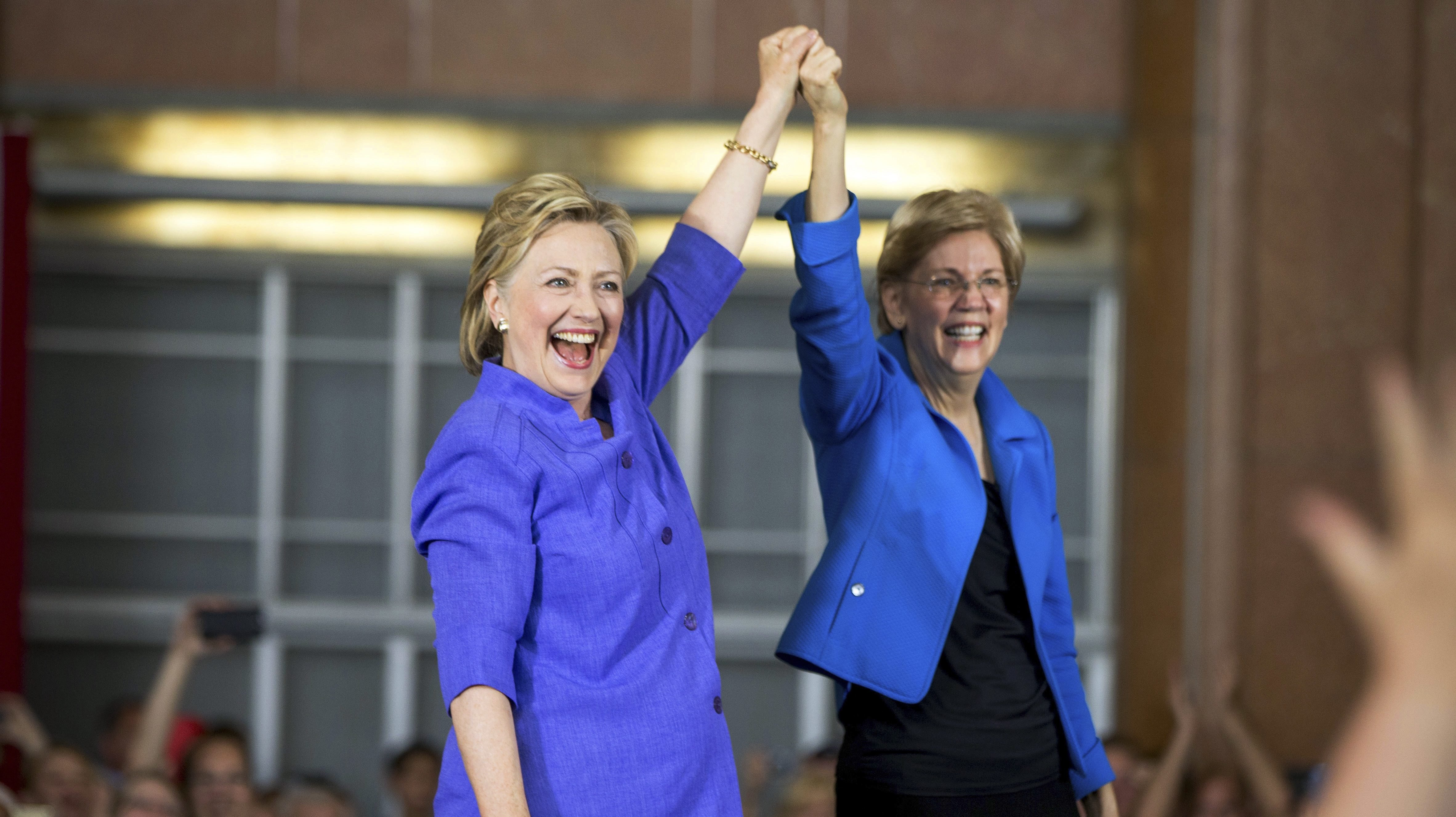 FILE - In this June 27, 2016, file photo, Democratic presidential candidate Hillary Clinton, accompanied by Sen. Elizabeth Warren, D-Mass., arrives to speak at the Cincinnati Museum Center at Union Terminal in Cincinnati. Warren is being considered as a vice presidential pick for Clinton. (AP Photo/Andrew Harnik, File)