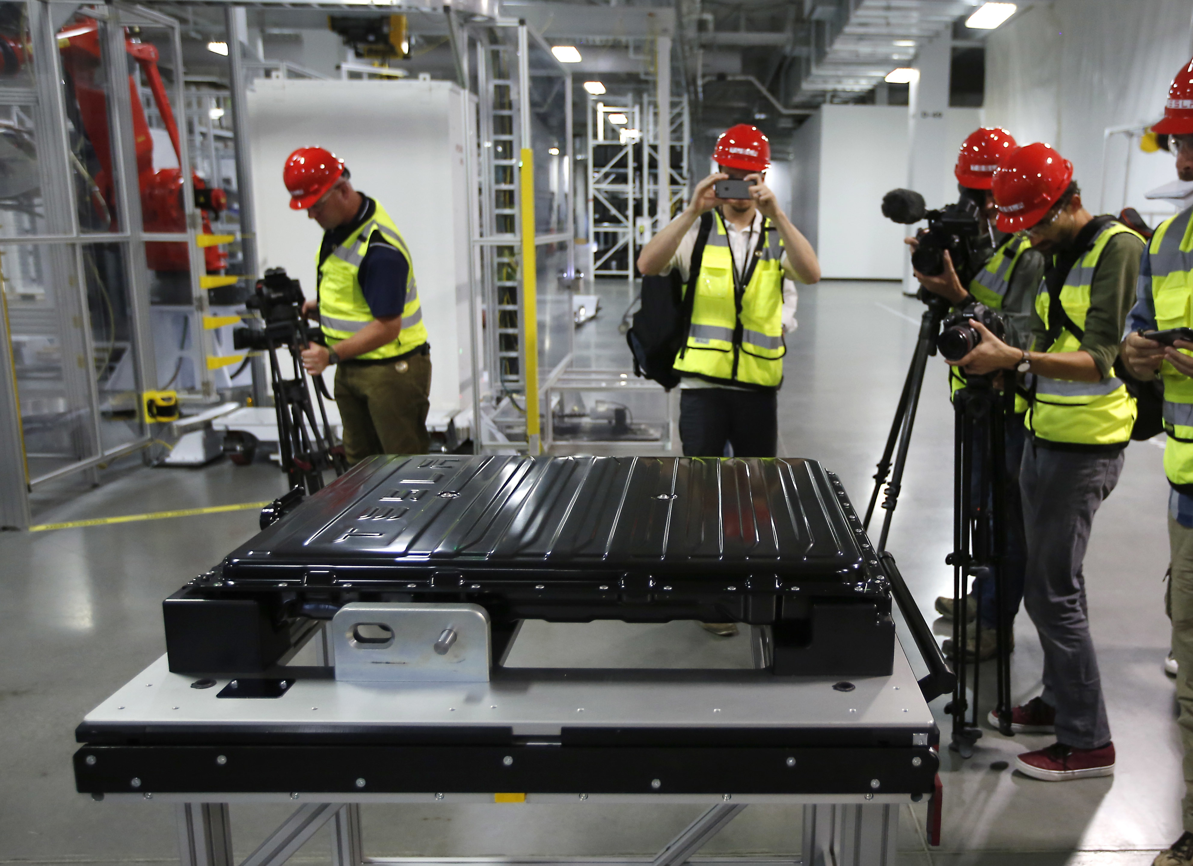 A Tesla battery pack is displayed during a media tour of the new Tesla Motors Inc., Gigafactory Tuesday, July 26, 2016, in Sparks, Nev. It's Tesla Motors biggest bet yet: a massive, $5 billion factory in the Nevada desert that could almost double the world's production of lithium-ion batteries by 2018. (AP Photo/Rich Pedroncelli)
