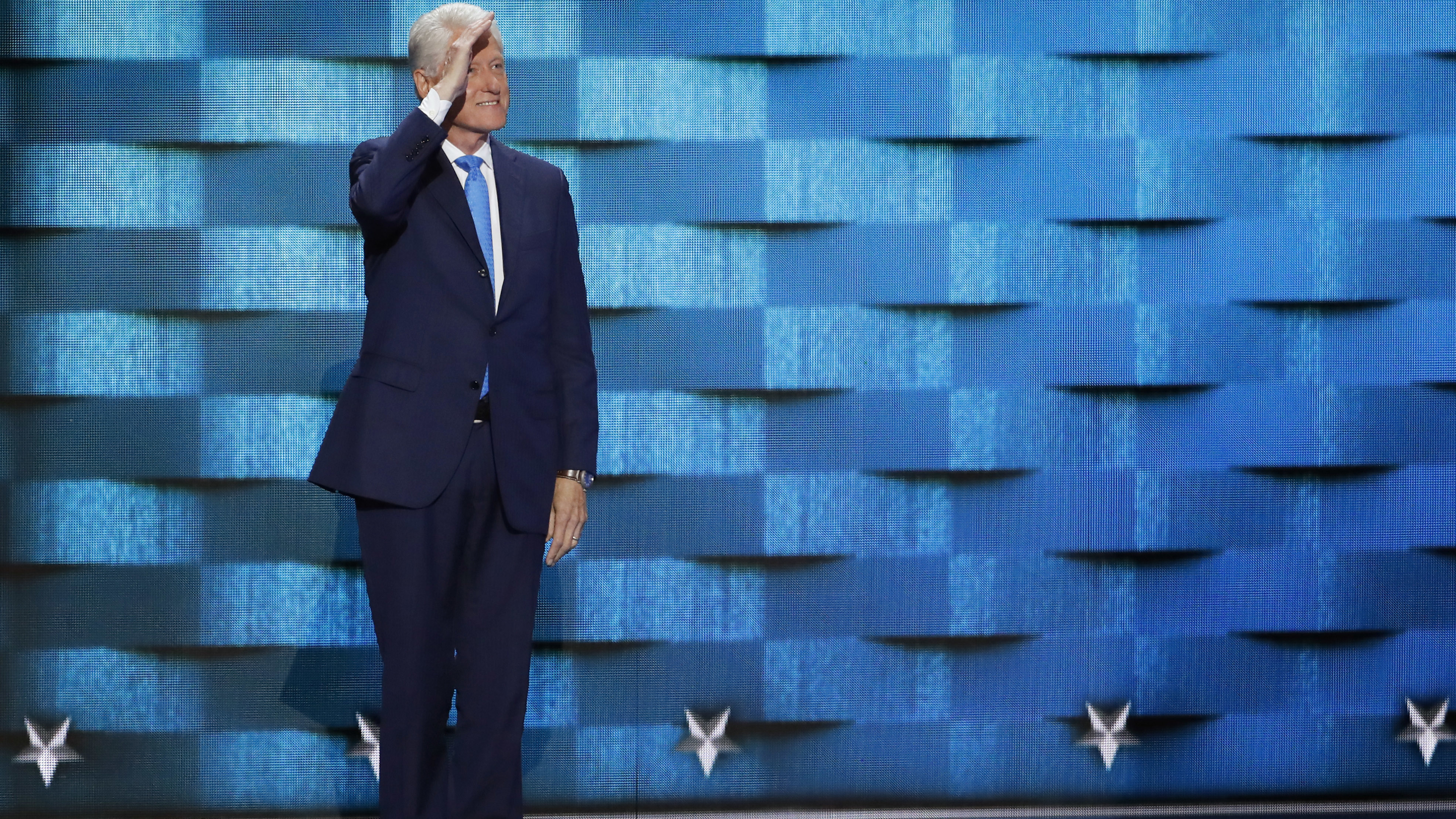Former President Bill Clinton salutes before speaking during the second day of the Democratic National Convention in Philadelphia , Tuesday, July 26, 2016. (AP Photo/J. Scott Applewhite)