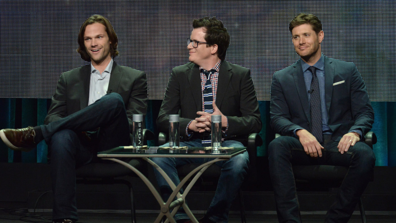 "From left, Jared Padalecki, Producer Jeremy Carver and Jensen Ackles speak on stage during the ""Supernatural"" panel at the The CW 2014 Summer TCA held at the Beverly Hilton Hotel on Friday, July 18, 2014, in Beverly Hills, Calif. (Photo by Richard Shotwell/Invision/AP)"