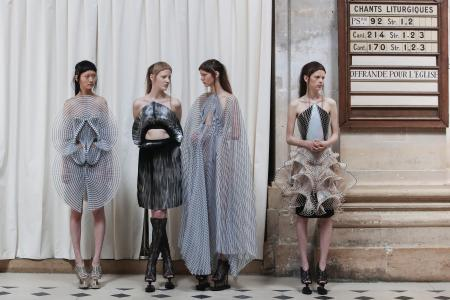 Models wait before the show, as they wear creations for Iris Van Herpen's Haute Couture Fall-Winter 2016-2017 collection presented Monday, July 4, 2016 in Paris. (AP Photo/Kamil Zihnioglu)