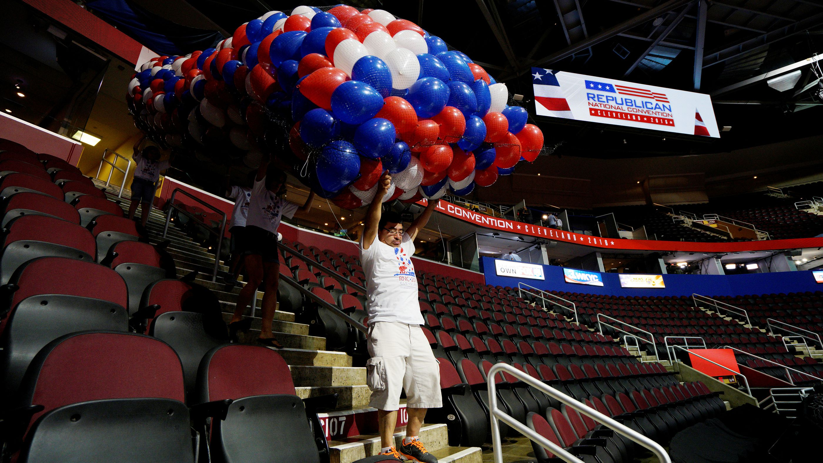 Workers carry balloons in the Quicken Loans Arena, site of the Republican National Convention in Cleveland.