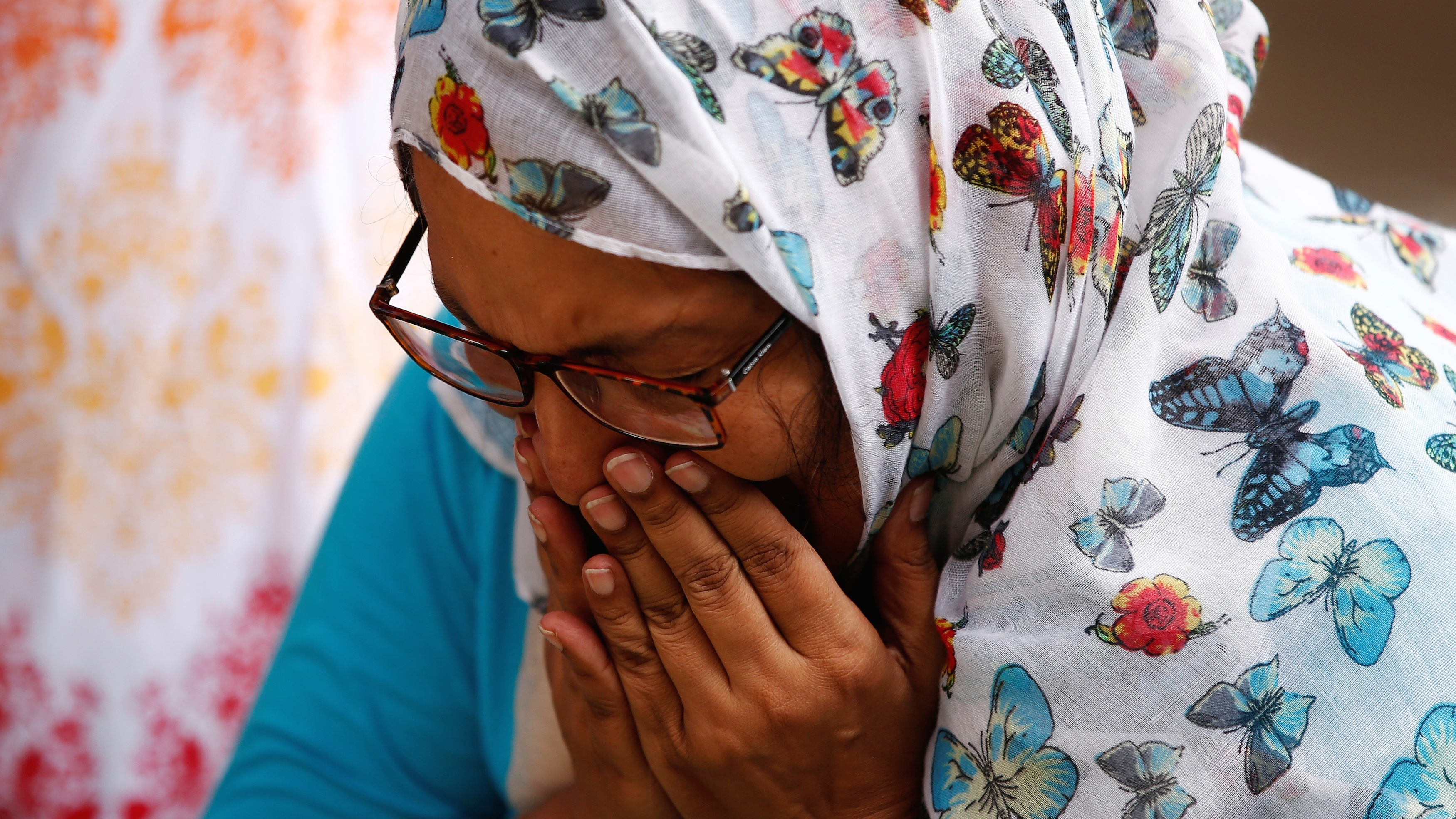 A woman mourns for the victims who were killed in the attack on a restaurant in Dhaka, Bangladesh.