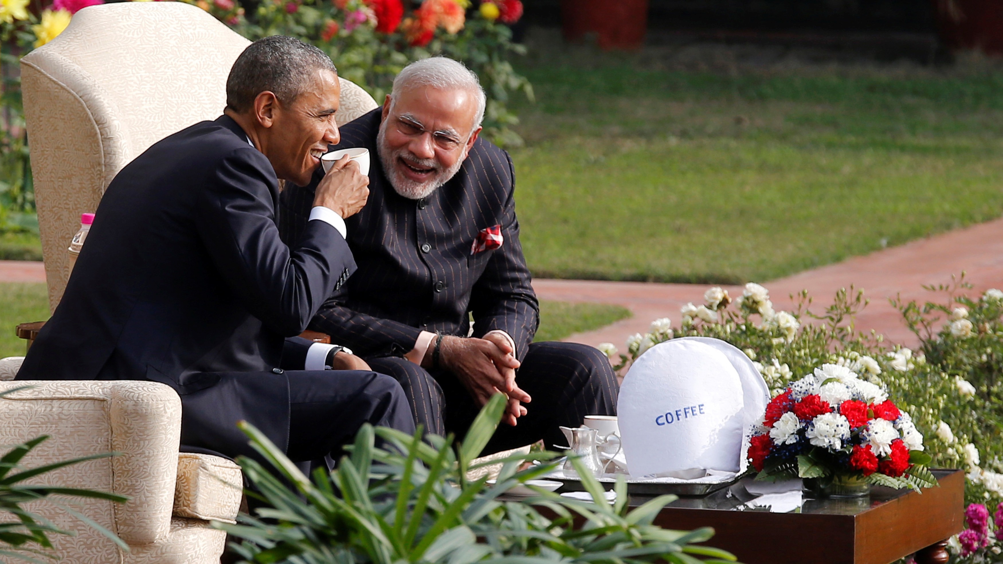 U.S. President Barack Obama and India's Prime Minister Narendra Modi (R) talk as they have coffee and tea together in the gardens of Hyderabad House in New Delhi January 25, 2015.