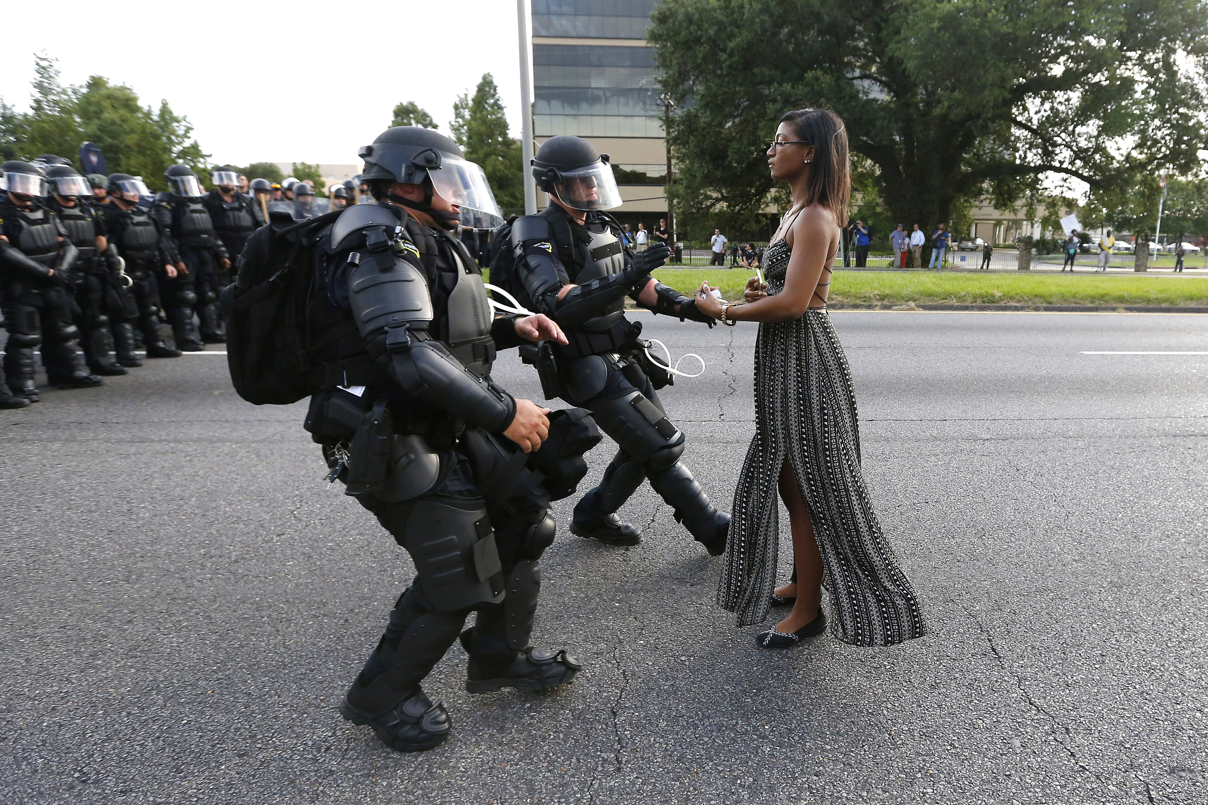 A demonstrator protesting the shooting death of Alton Sterling is detained by law enforcement near the headquarters of the Baton Rouge Police Department in Baton Rouge, Louisiana, U.S. July 9, 2016.  REUTERS/Jonathan Bachman     TPX IMAGES OF THE DAY      - RTSH3XR