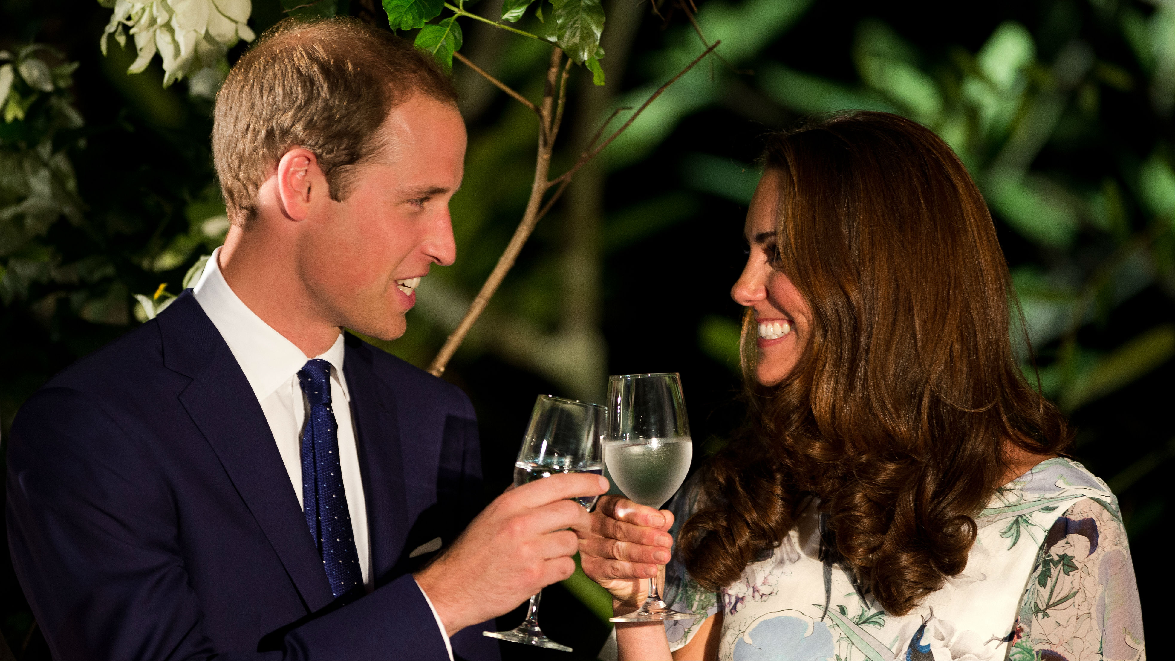 Britain's Prince William and his wife Catherine, the Duchess of Cambridge, make a toast in the honor of Queen Elizabeth's Diamond Jubilee at a British Gala reception at the Eden Hall in Singapore on Wednesday September 12, 2012. Britain's Prince William and his wife Catherine arrived in Singapore on September 11 to kick off a nine-day Southeast Asian and Pacific tour marking Queen Elizabeth II's Diamond Jubilee.