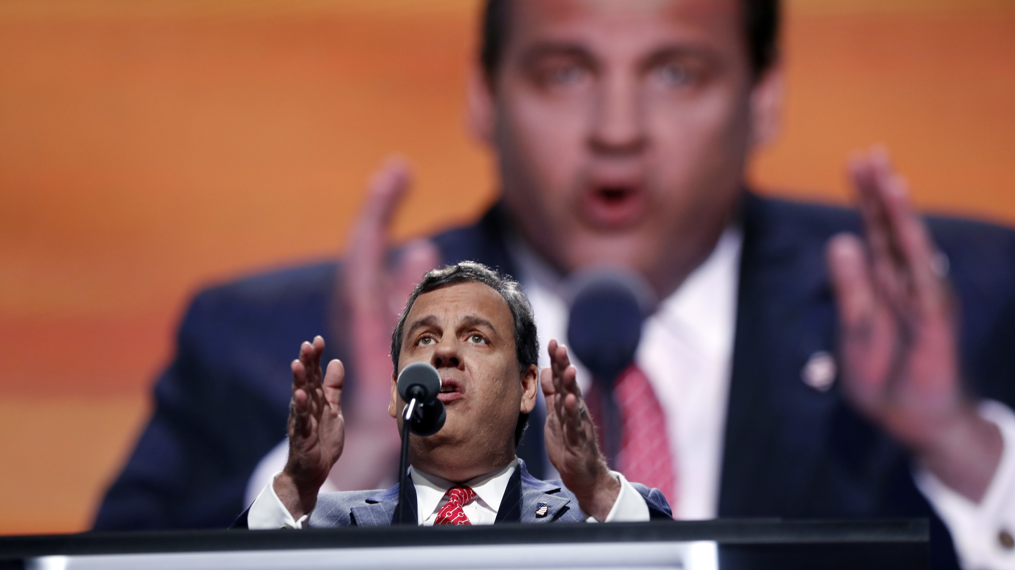 """New Jersey governor Chris Christie """"prosecutes"""" Hillary Clinton, in absentia, for crimes against the world."""