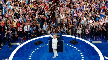 Democratic presidential nominee Hillary Clinton turns a waves at delegates before speaking during the final day of the Democratic National Convention in Philadelphia , Thursday, July 28, 2016