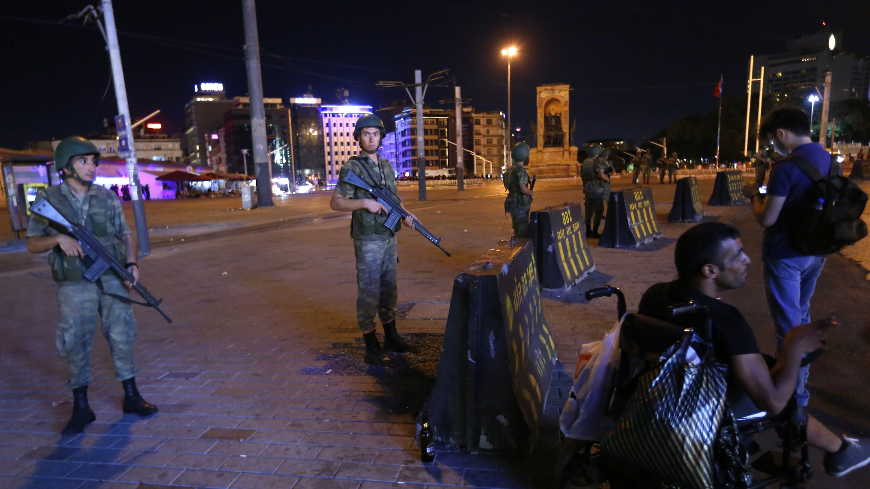 Turkish military stand guard near Taksim Square in Istanbul following a coup against the government of president Erdogan.