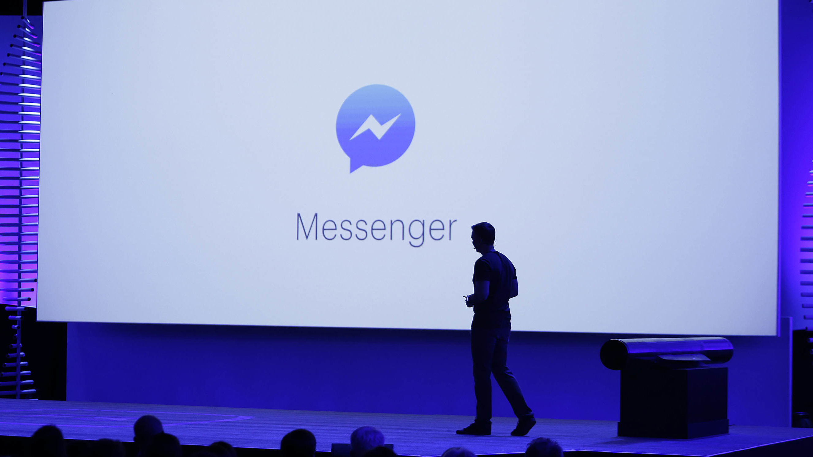 """FILE - In this Tuesday, April 12, 2016 file photo, David Marcus, Facebook Vice President of Messaging Products, watches a display showing new features of Messenger during the keynote address at the F8 Facebook Developer Conference in San Francisco. On Friday, July 8, 2016, the company says it is testing an option for """"secret conversations,"""" encrypted chats that can only be read by the people sending and receiving the messages, to its Messenger app. (AP Photo/Eric Risberg)"""