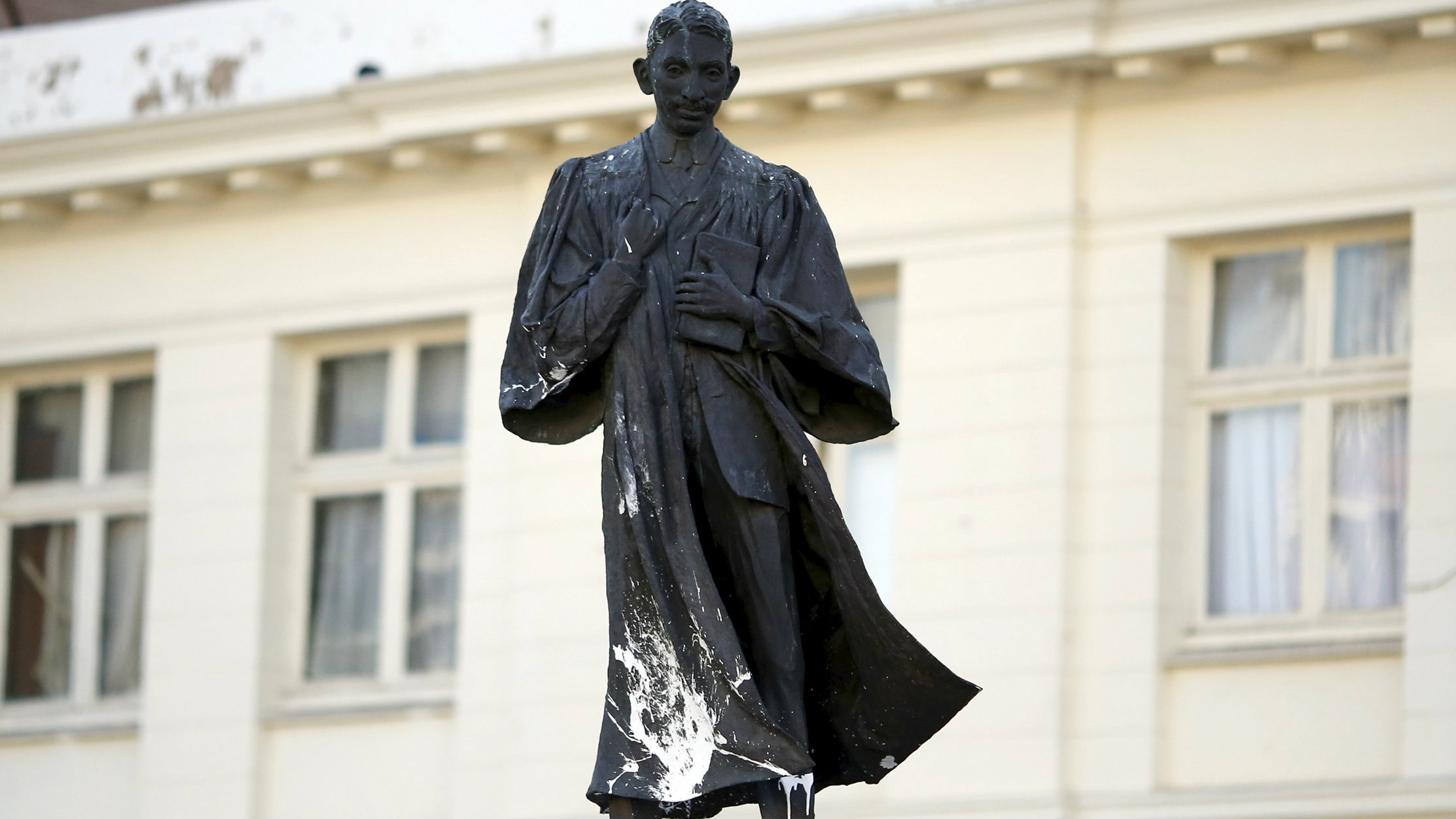 A statue of Mahatma Gandhi is seen after it was vandalized with white paint at Ghandi Square in Johannesburg April 13, 2015.