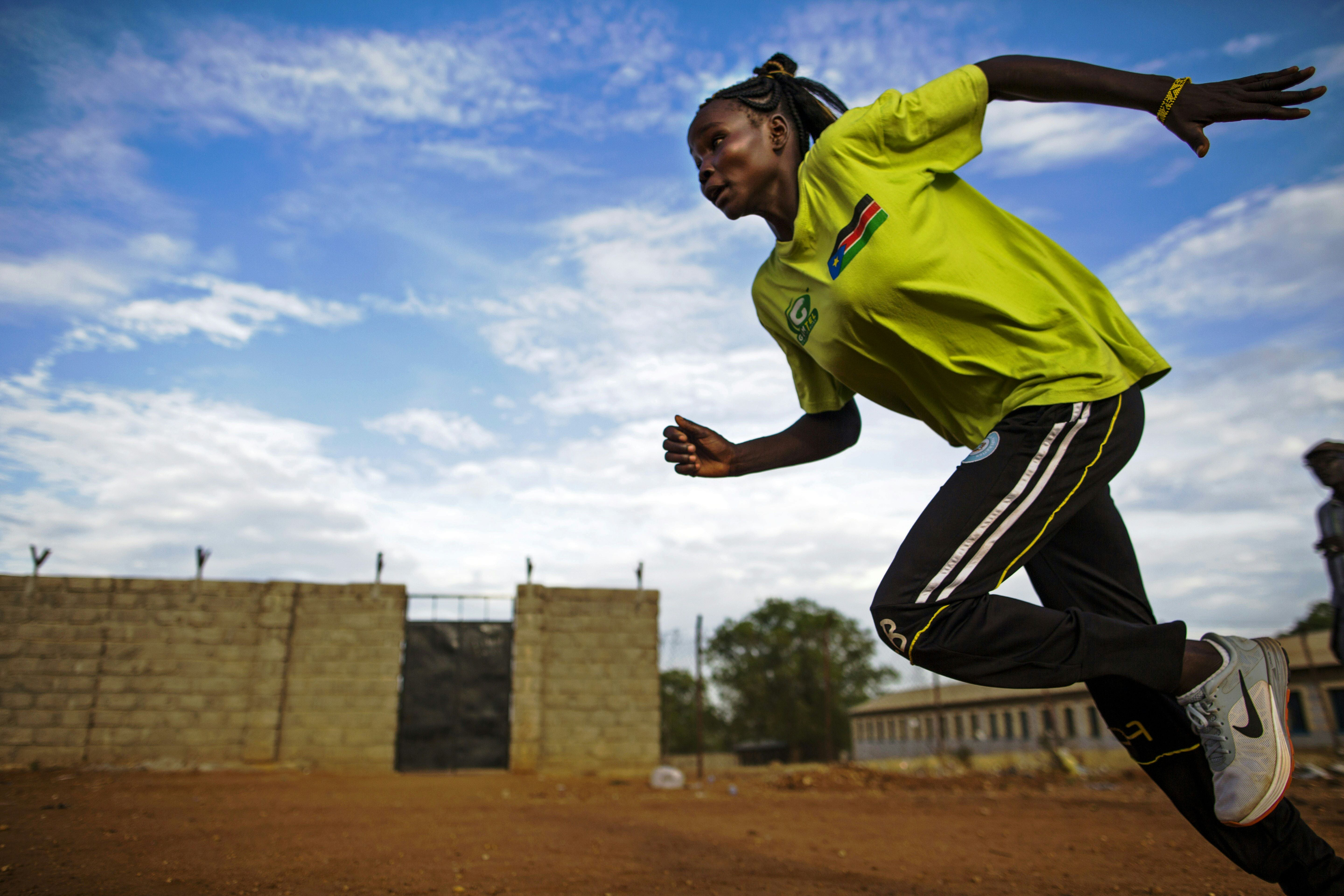Margret Rumat Rumar Hassan, 19 years old, from Wau, South Sudan, trains at the open field of the Buluk Athletics Track in Juba, South Sudan.