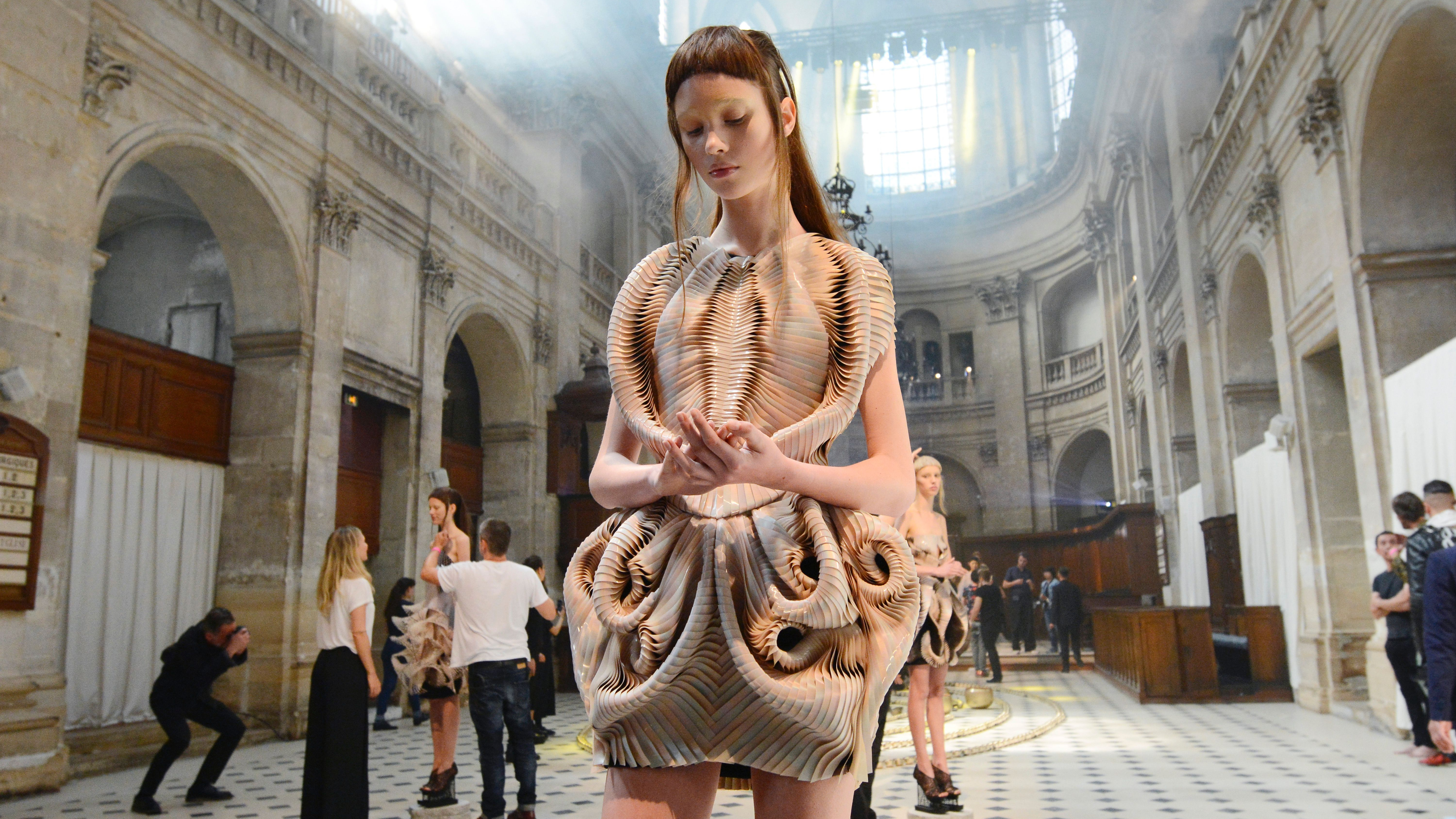 A model presents a creation by Iris Van Herpen after the 2016-2017 fall/winter Haute Couture collection fashion show on July 4, 2016 in Paris.