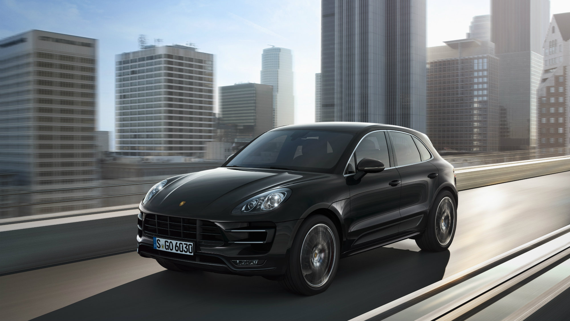 Commercial handout image released by Porsche Holding SE on 20 November showing the Porsche Macan Turbo.  Porsche is expanding its range to include a whole new class of vehicle. The Macan is the first Porsche model to break into the compact SUV segment and is poised to set new standards in the field of driving dynamics and enjoyment – on both paved streets uneven terrain.