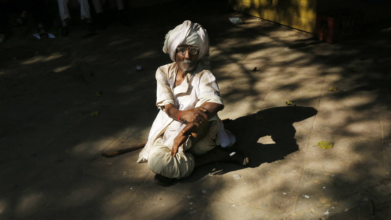 Indian elderly looking man sit during a protest demanding a universal old age pension of amount INR 2000 (32.7USD) a month for people above 60 years in New Delhi, India on 28 November 2013. According to the current government scheme people above the 60 years of age getting INR 200 (USD 3) per month. Pension Parishad organization and 150 organizations from all over India have given their support to this protests and to their other demands.