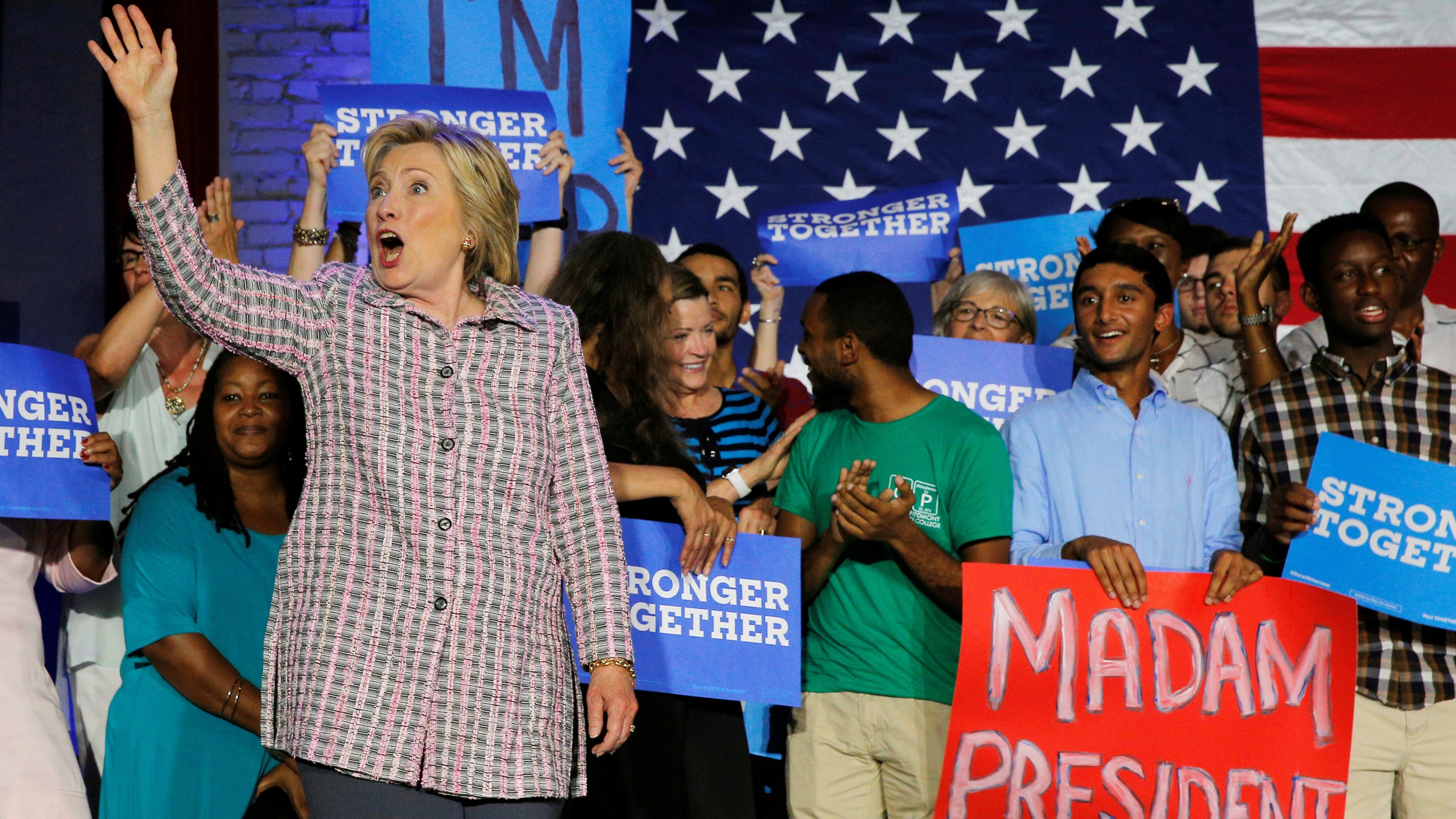 U.S. Democratic presidential candidate Hillary Clinton reacts to the cheers from campaign volunteers in Charlotte, North Carolina, U.S. July 25, 2016.  REUTERS/Brian Snyder - RTSJKK2