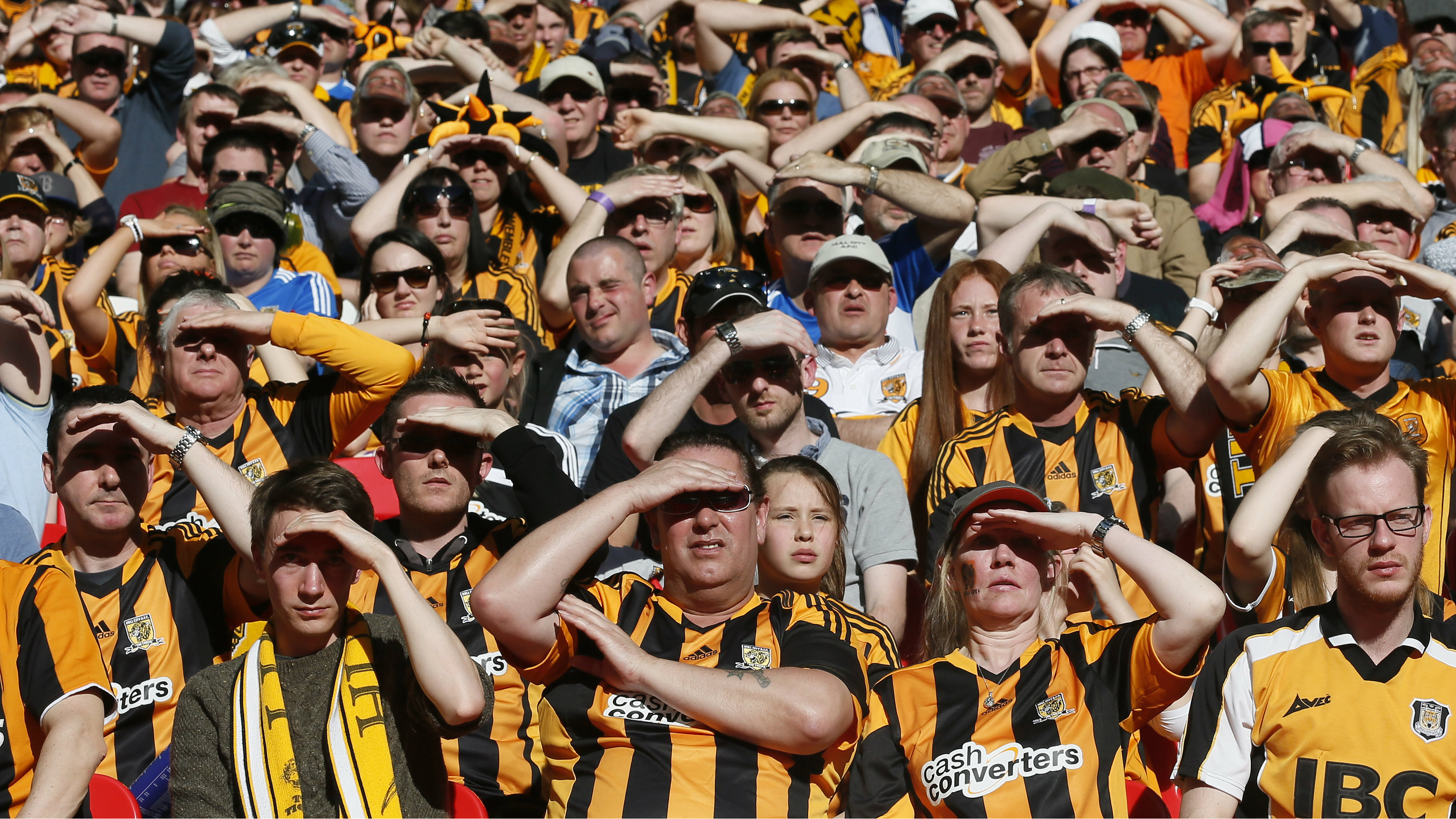 Hull City's fans watch their English FA Cup semi-final soccer match against Sheffield United at Wembley Stadium during a sunny day in London April 13, 2014.