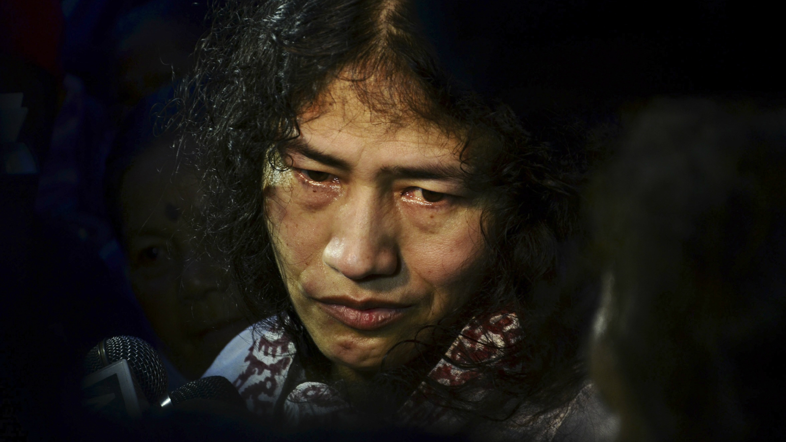 In this Wednesday, Aug. 20, 2014 photo, Irom Sharmila speaks to the media outside a security ward after her release in Porompal district, in Imphal, India. India's most famous prisoner of conscience walked free after nearly 14 years in jail but vowed to continue the hunger strike that landed her in prison for attempted suicide. Sharmila, 42, has not eaten a single morsel of food voluntarily since November 2000, when she began her protest against an Indian law that suspends many human rights protections in areas of conflict.