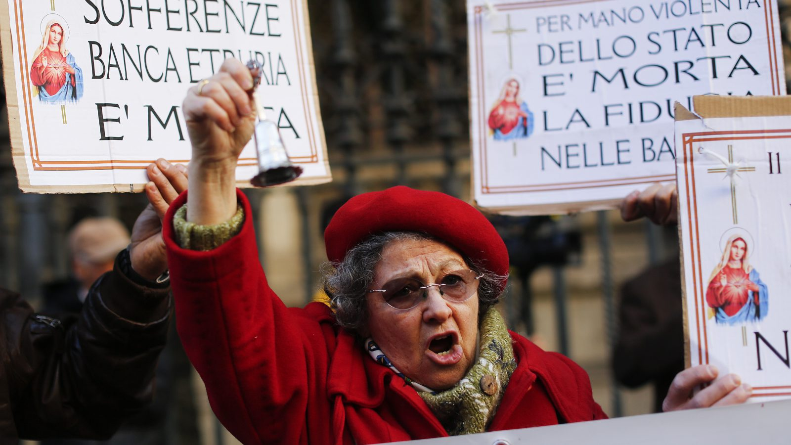 A woman reacts in front of the Bank of Italy during a protest after a bank rescue last month left bitter families marooned in Rome, Italy December 22, 2015. REUTERS/Alessandro Bianchi - RTX1ZR3F