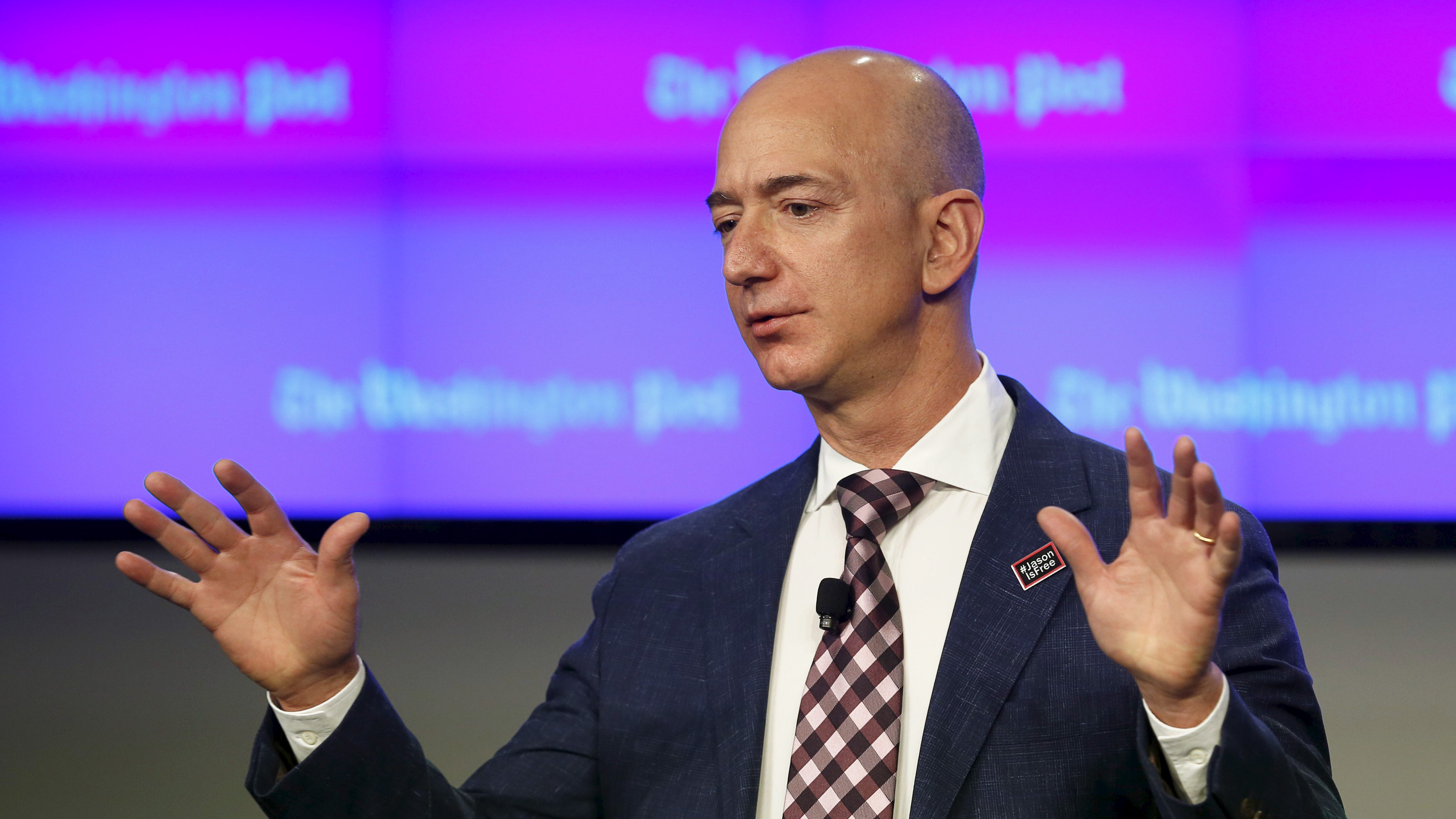 Jeff Bezos, owner of The Washington Post, delivers remarks at the grand opening of the Washington Post newsroom in Washington January 28, 2016.  REUTERS/Gary Cameron - RTX24G34