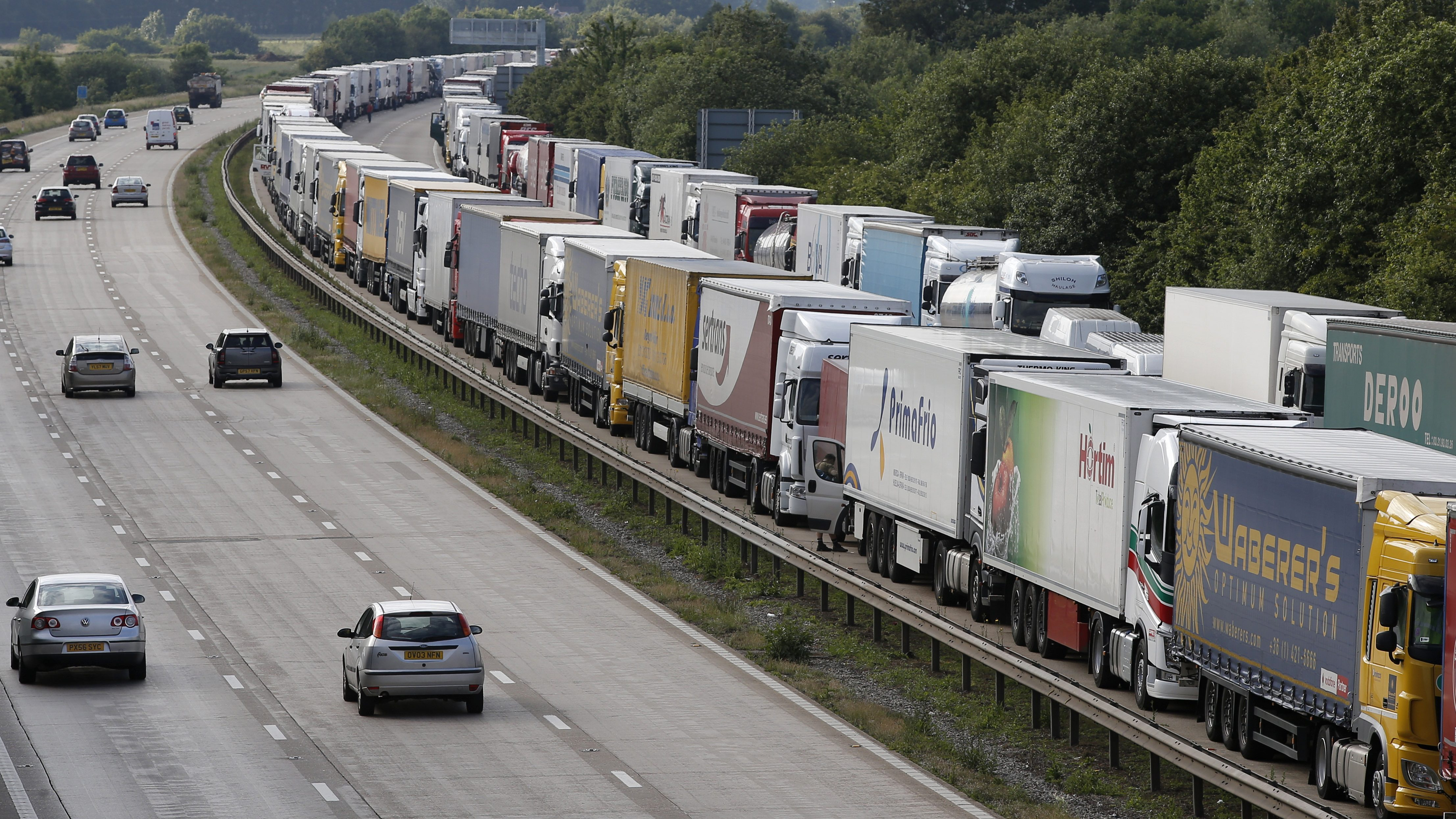 Lorries are backed up on the M20 motorway which leads from London to the Channel Tunnel terminal at Ashford and the Ferry Terminal at Dover