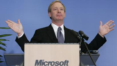 Microsoft General Counsel Smith gestures during a news conference in Brussels
