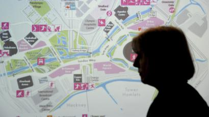 Britain's Home Secretary Theresa May stands in front of a map of the Olympic Park during a visit to the London 2012 Olympic Games security control room in the Olympic Park, in Stratford, east Londo