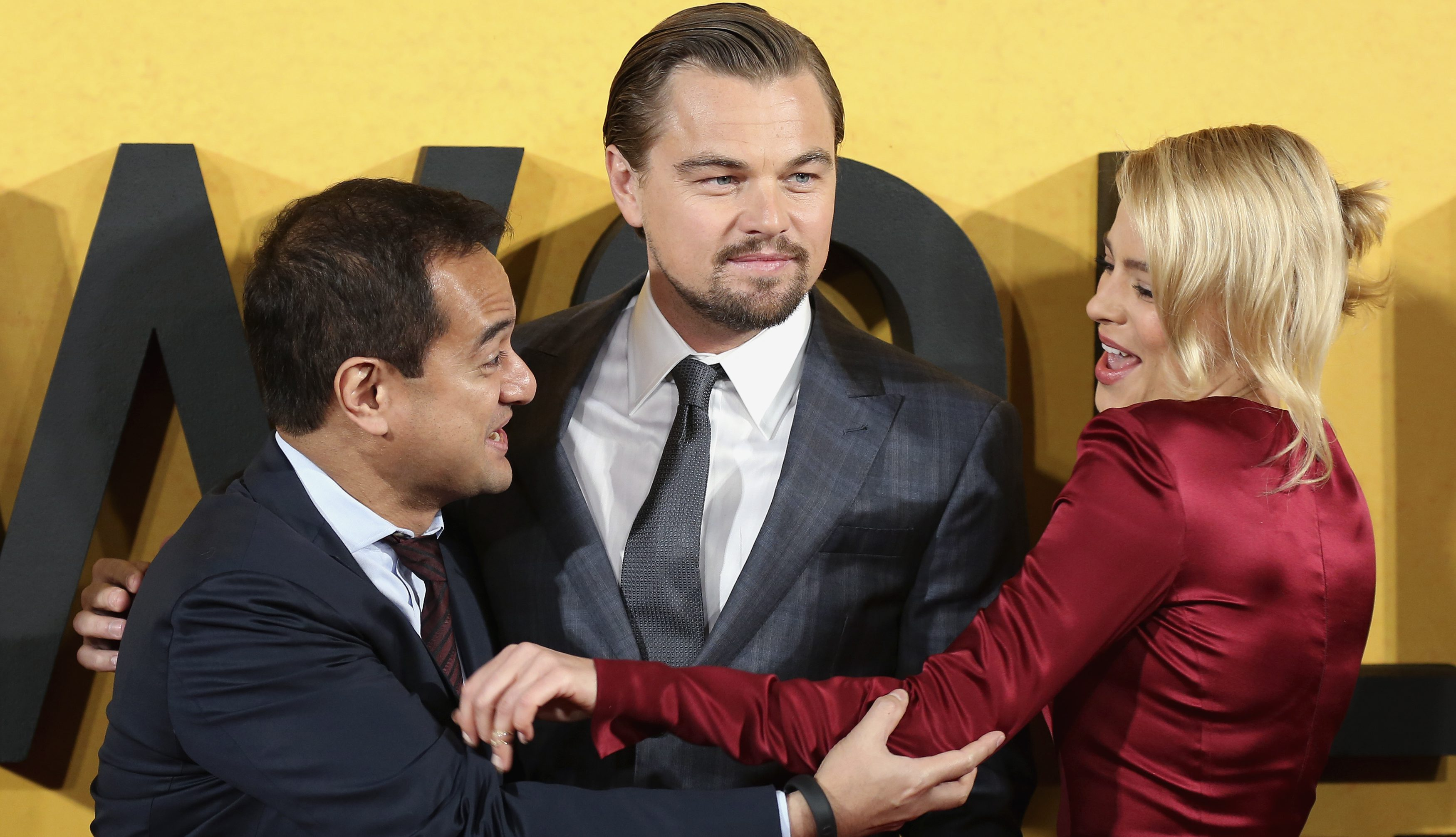 """Producer Riza Aziz (L), and cast members Leonardo DiCaprio and Margot Robbie arrive for the U.K. Premiere of """"The Wolf of Wall Street"""" at Leicester Square, London January 9, 2014."""