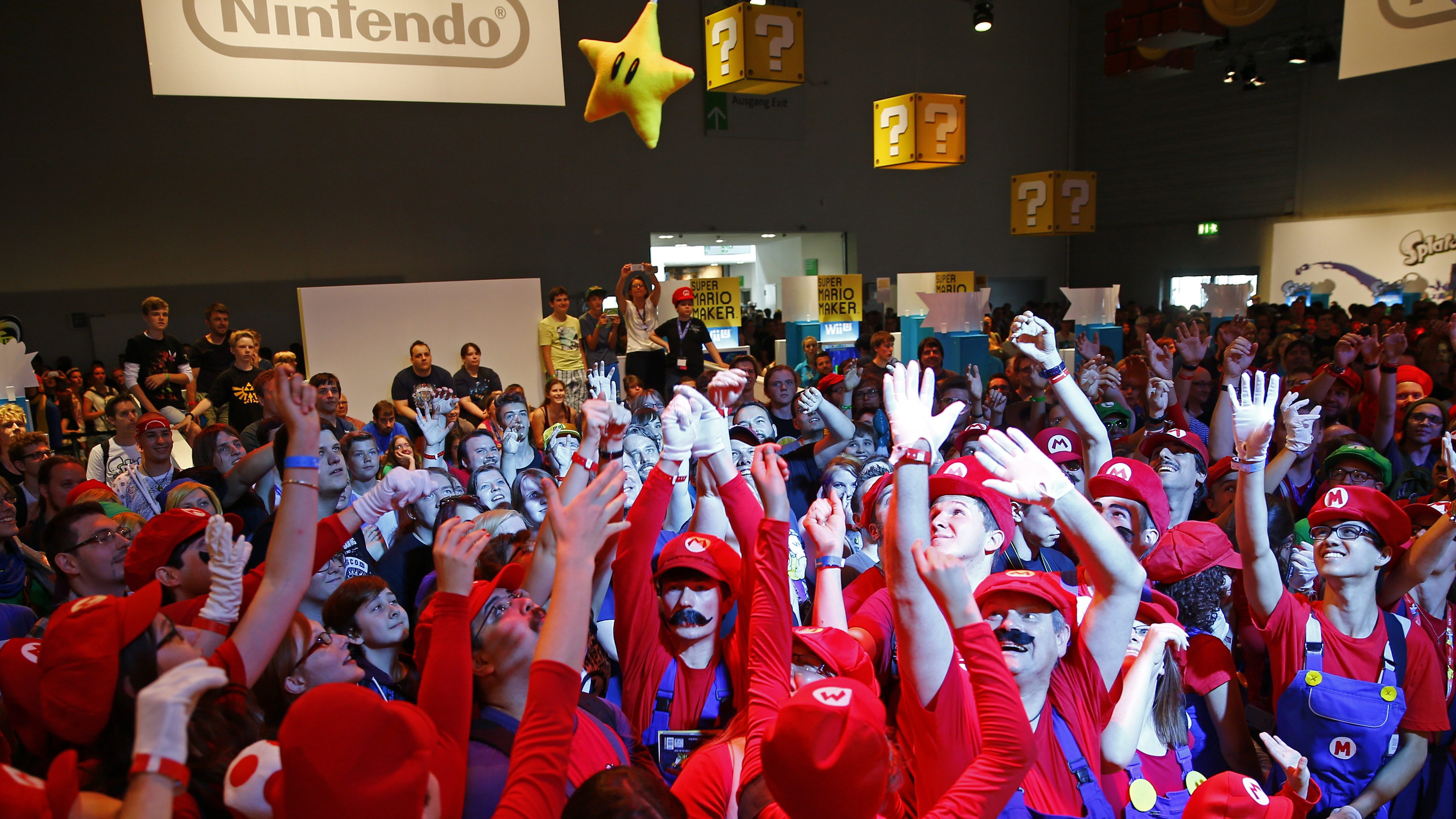 "Cosplayers dressed as character ""Mario"" celebrate the 30th anniversary of ""Super Mario Bros."" video games developed by Nintendo during the Gamescom 2015 fair in Cologne, Germany August 6, 2015. The Gamescom convention, Europe's largest video games trade fair, runs from August 5 to August 9."