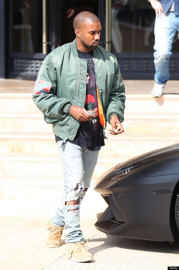 Kanye West Los Angeles November 4 2013 Kanye West leaving Barneys New York in Beverly Hills, wearing his Yeezus Tour flight jacket and driving away in his Lamborghini Aventador ID revpix131104201 All pictures must be credited revolutionpix