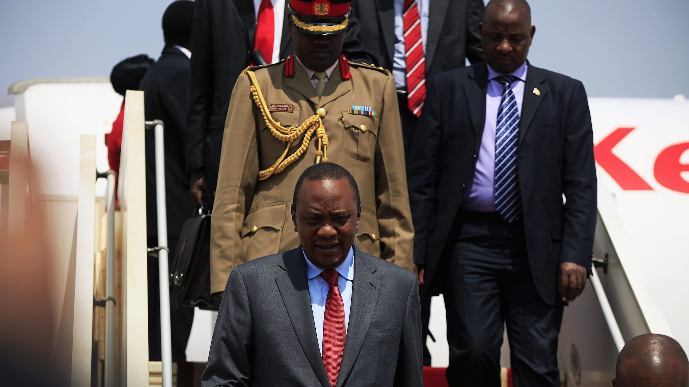 Kenya's President Uhuru Kenyatta (bottom L) arrives at the airport in Juba,