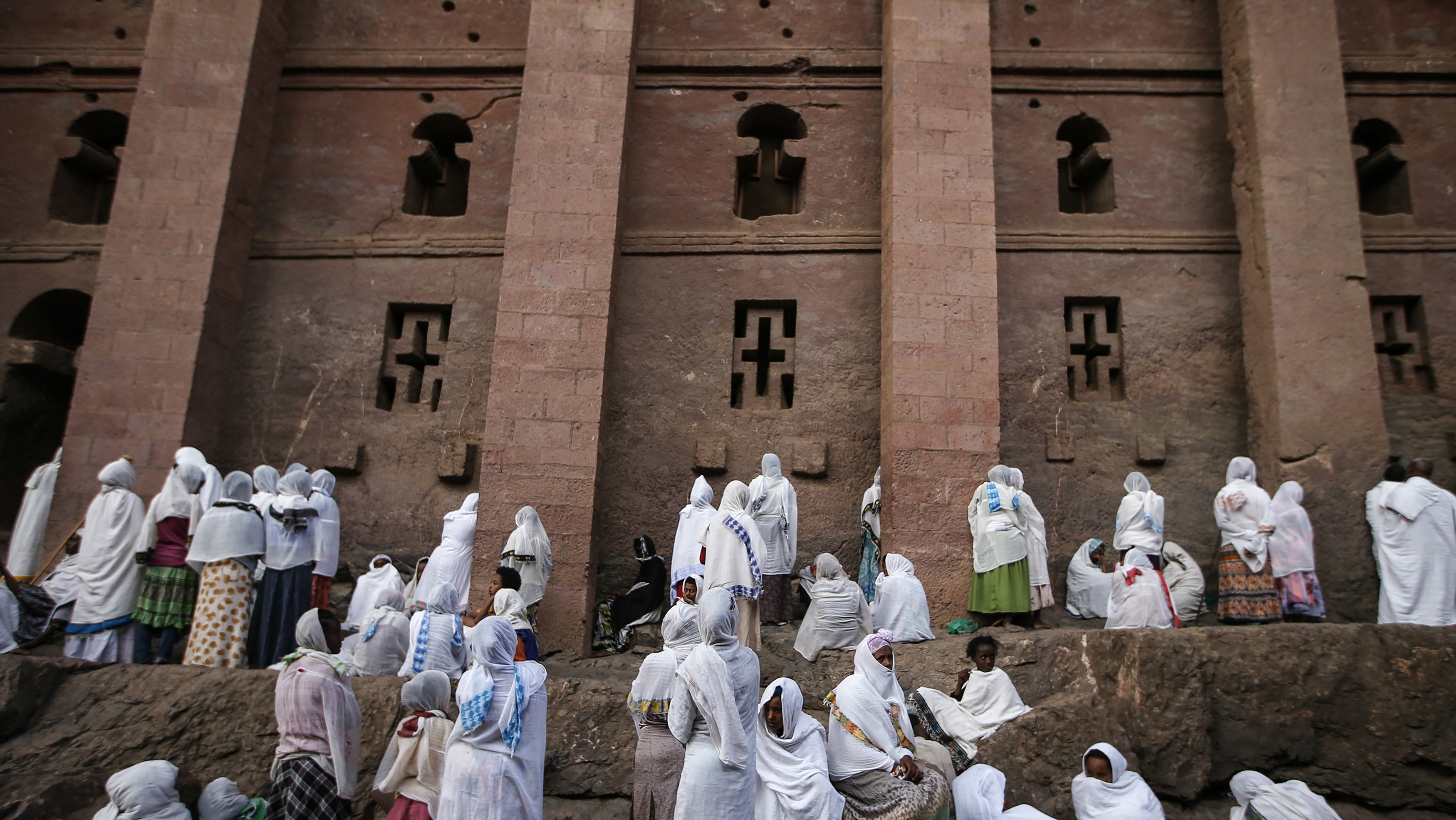 Orthodox Christians pray outside the famous monolithic rock-cut churches during a Good Friday celebration in Lalibela May 3, 2013