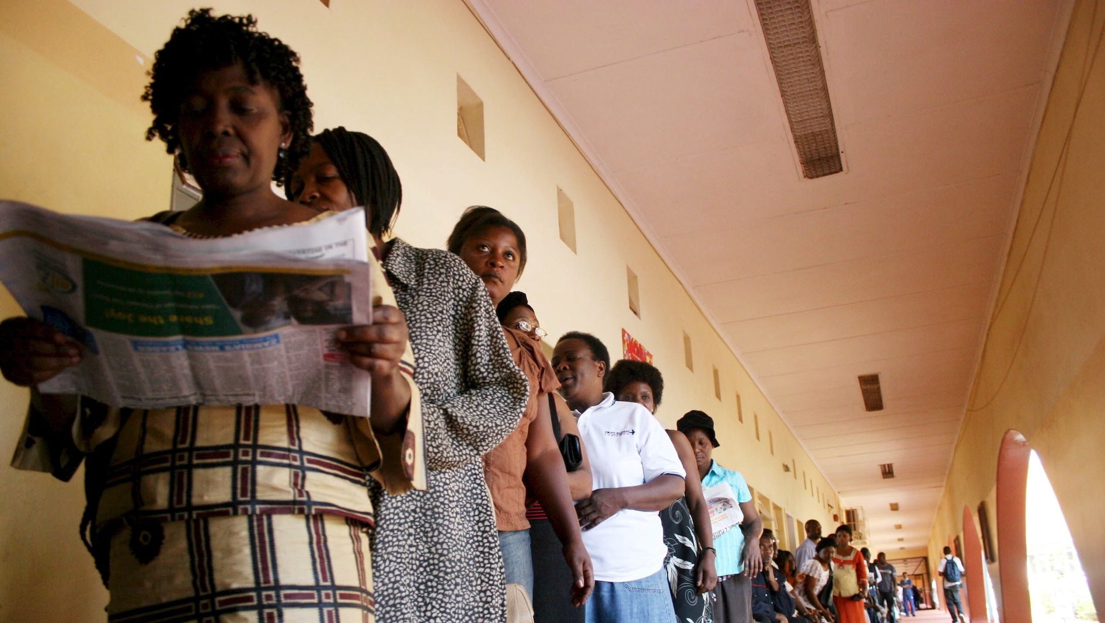 Voters wait their turn in Zambia.
