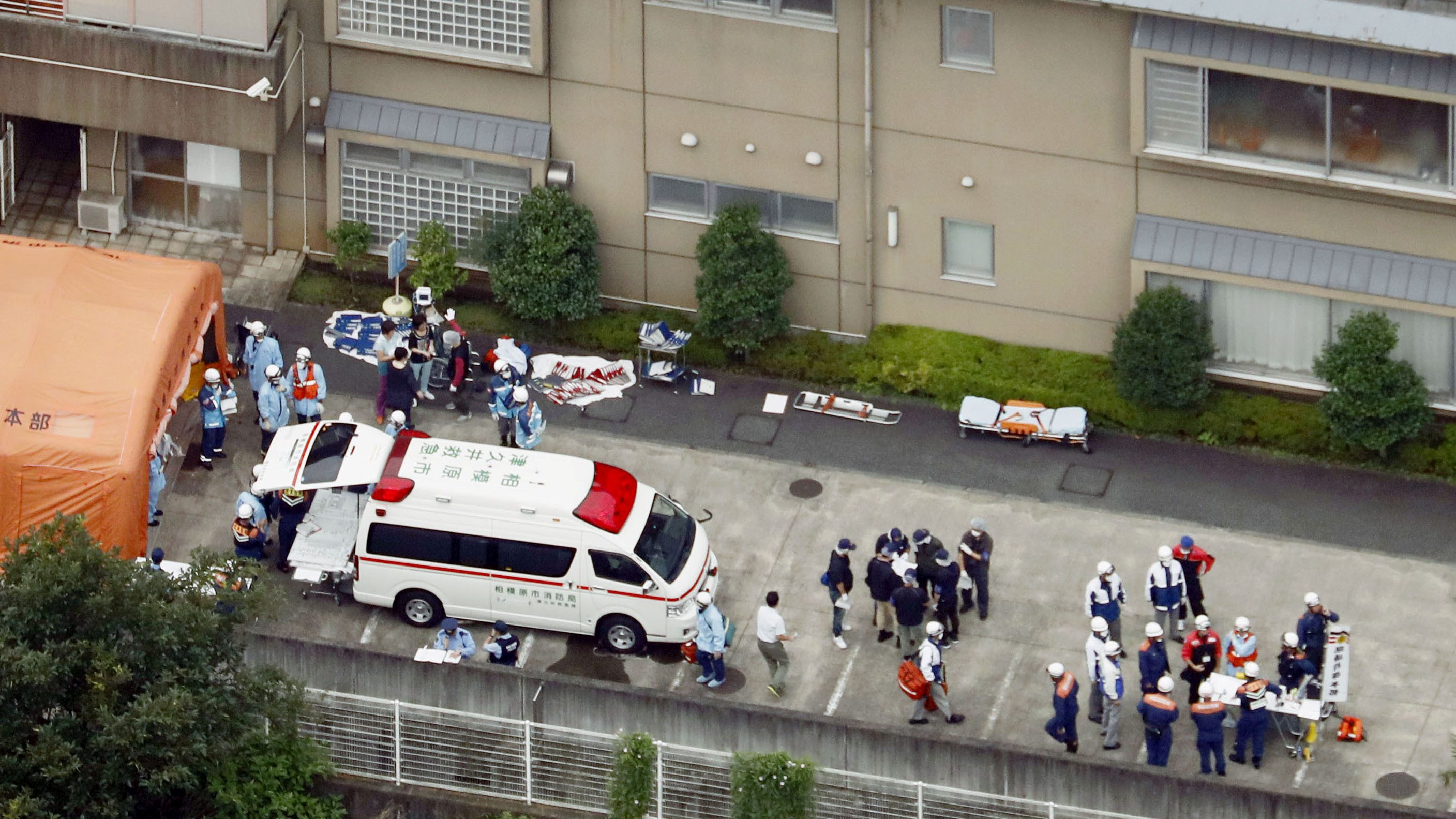 Police officers and rescue workers are seen in a facility for the disabled, where at least 19 people were killed and as many as 20 wounded by a knife-wielding man, in Sagamihara, Kanagawa prefecture, Japan.