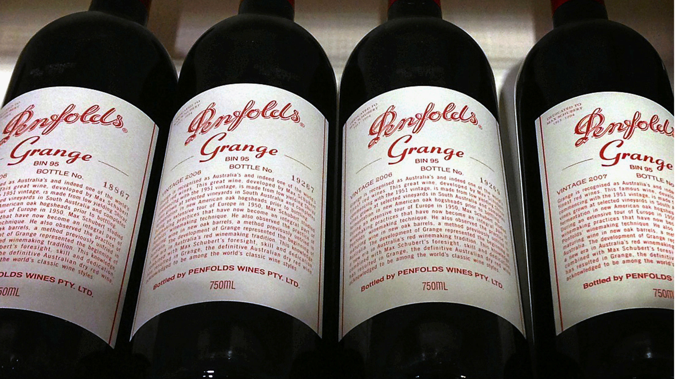 Bottles of Penfolds Grange, made by Australian wine maker Penfolds and owned by Australia's Treasury Wine Estates, sit on a shelf for sale at a wine shop in central Sydney, Australia, August 4, 2014.