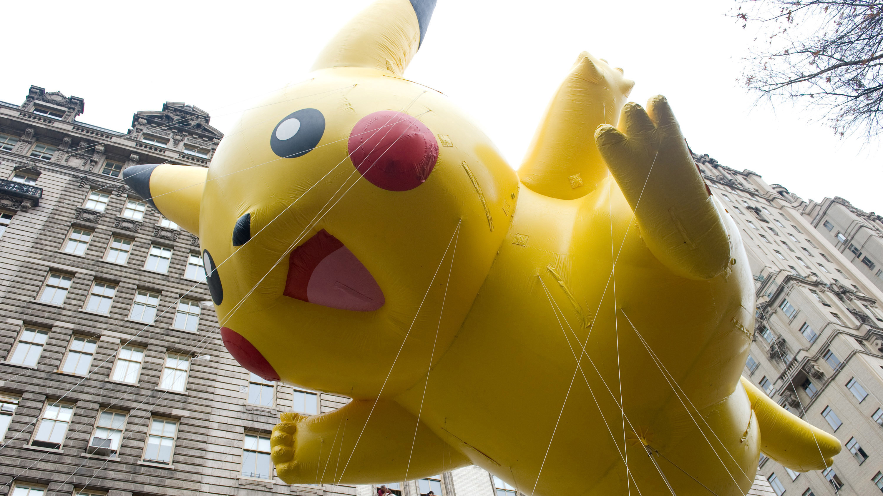 The Pikachu Pokemon balloon floats down Central Park West during the Macy's Thanksgiving Day Parade in New York, Thursday, Nov. 26, 2009. (AP Photo/Charles Sykes)