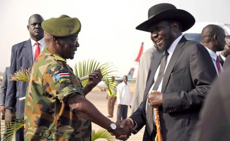 South Sudan's president Salva Kiir is received by chief of general staff of the Sudan People's Liberation Army, Paul Malong Awan at the airport in Juba, March 2015.