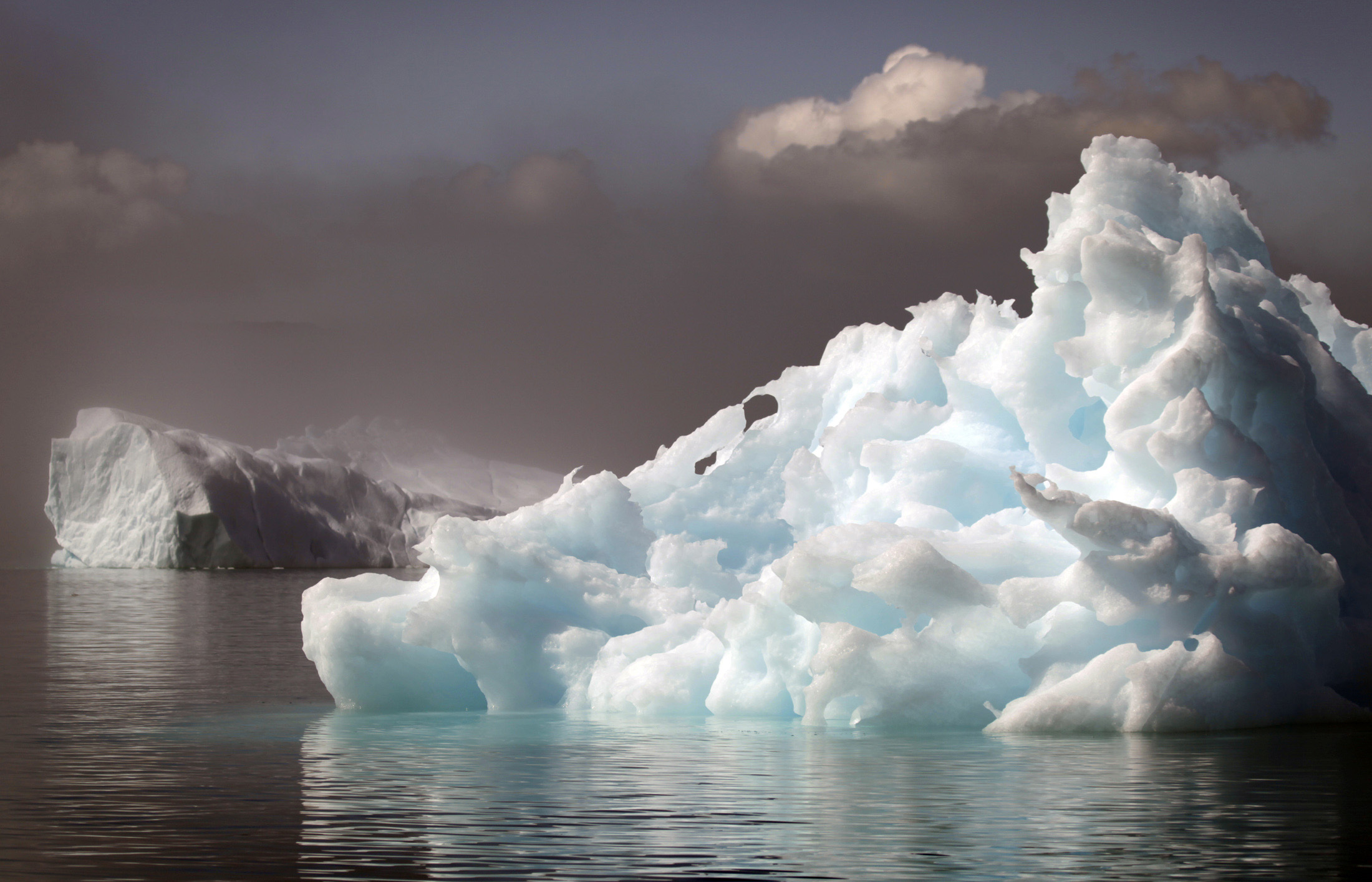Icebergs float in a fjord near the south Greenland town of Narsaq