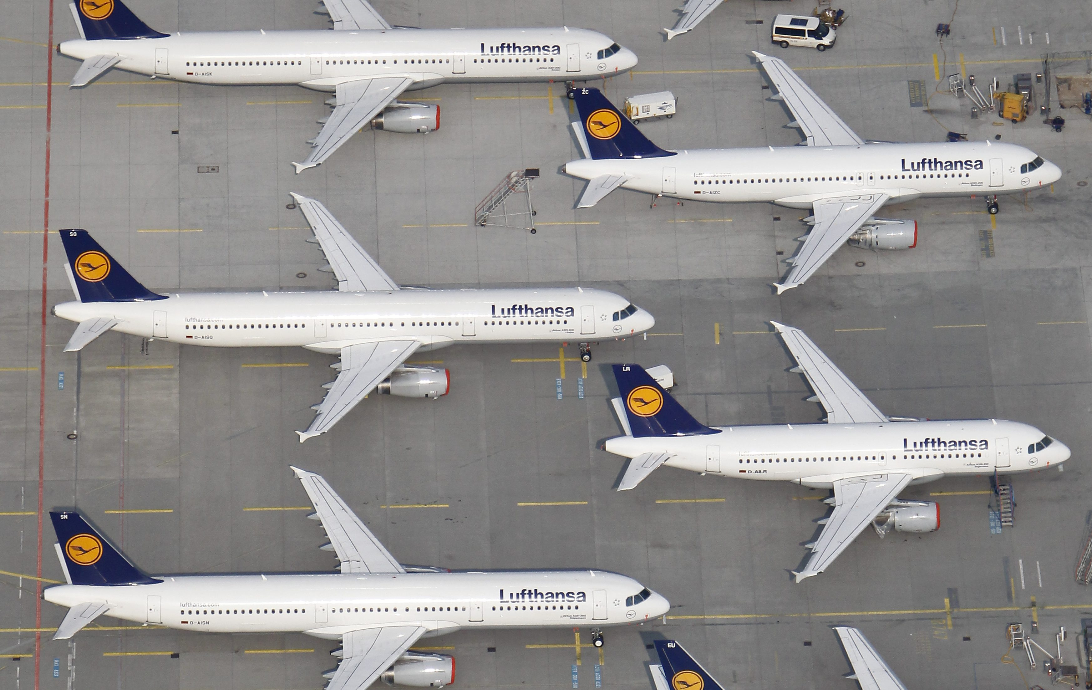 An aerial view shows Lufthansa planes parked on the tarmac of the closed Frankfurt's airport