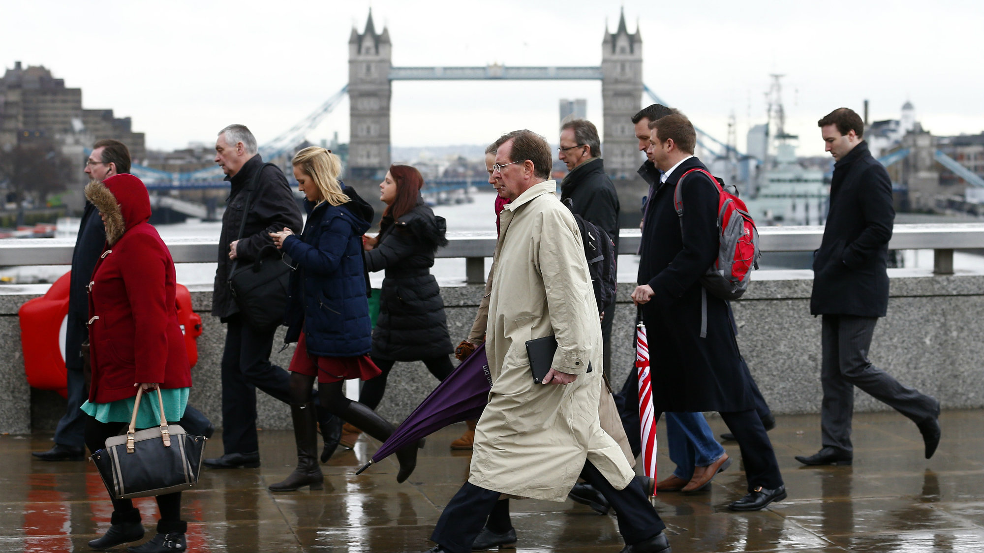 Tower Bridge is seen as workers cross London Bridge in London February 28, 2014.