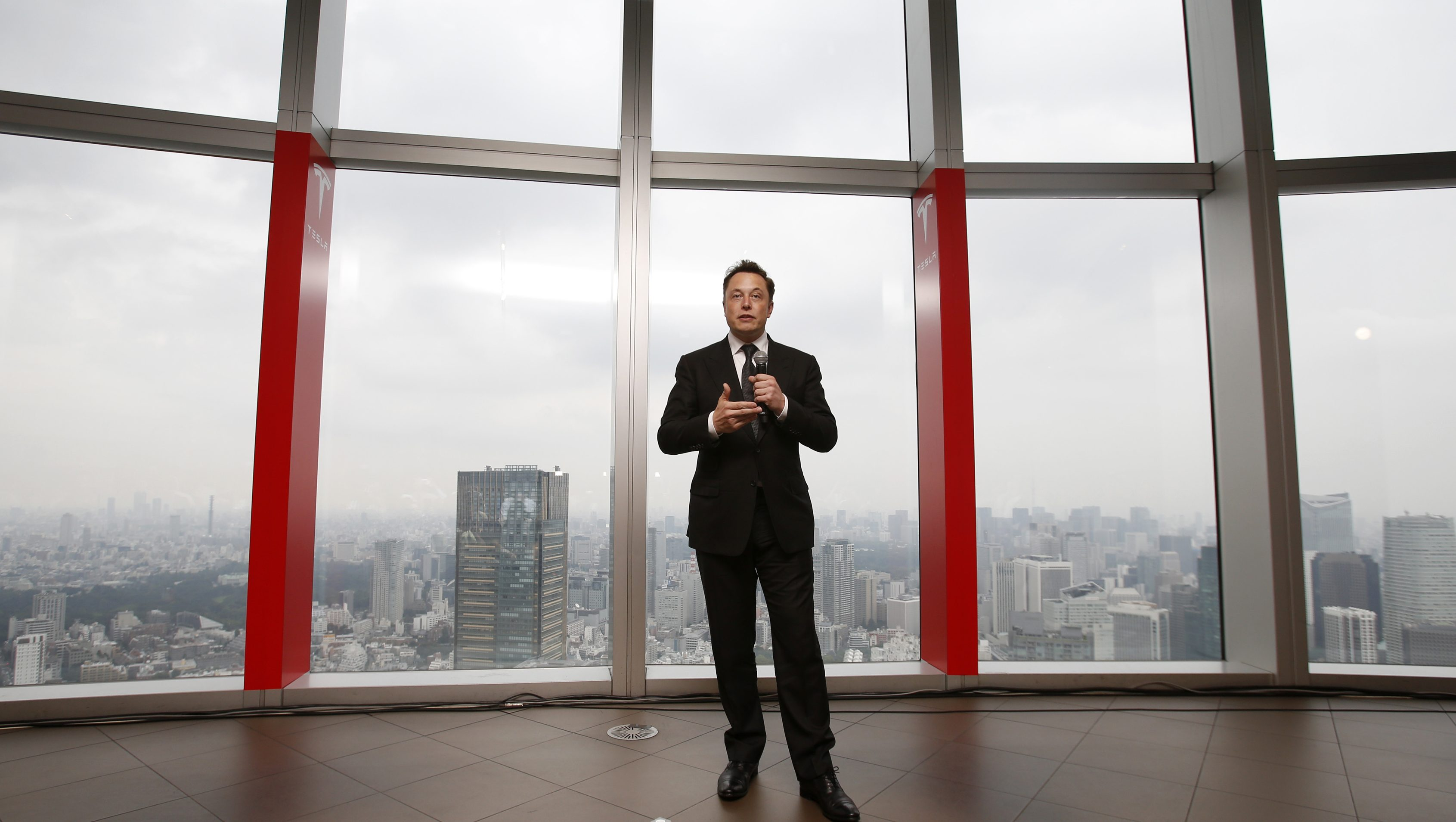 Tesla Motors Inc Chief Executive Elon Musk speaks during a news conference in Tokyo September 8, 2014. Musk said on Monday that he would not be surprised if there was a significant deal with Toyota Motor Corp in the next two to three years, though there were no definitive plans. REUTERS/Toru Hanai (JAPAN - Tags: BUSINESS TRANSPORT) - RTR45C8T
