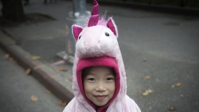 A child in a unicorn costume takes part in the 24th Annual Greenwich Village Children's Halloween Parade in the Manhattan borough of New York October 31, 2014. REUTERS/Carlo Allegri (UNITED STATES - Tags: SOCIETY) - RTR4CDVC