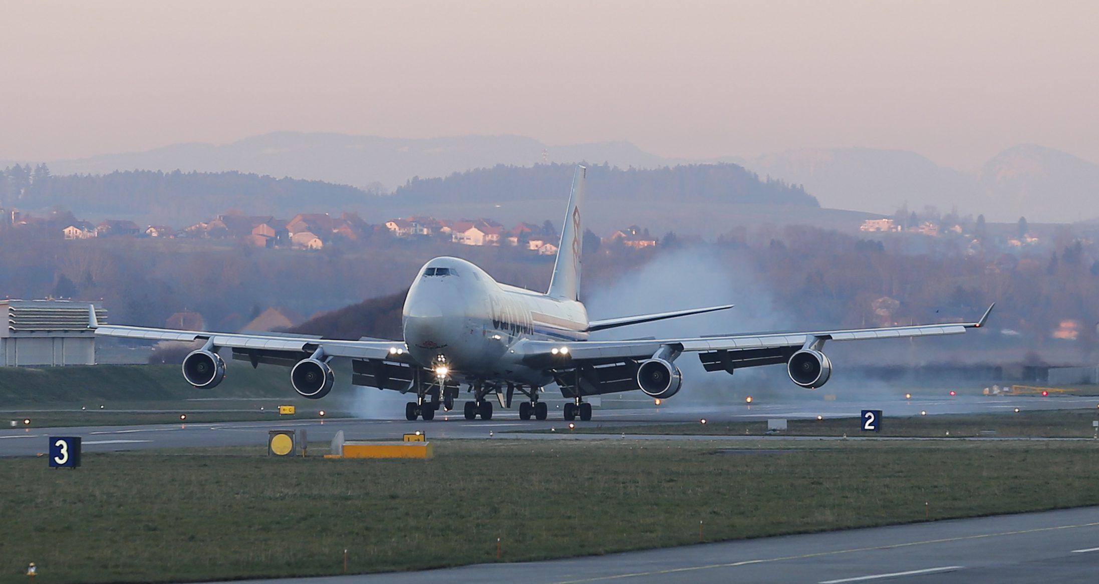 A Cargolux Boeing 747 cargo aircraft lands to load the Solar Impulse 2 aircraft at Payerne airport