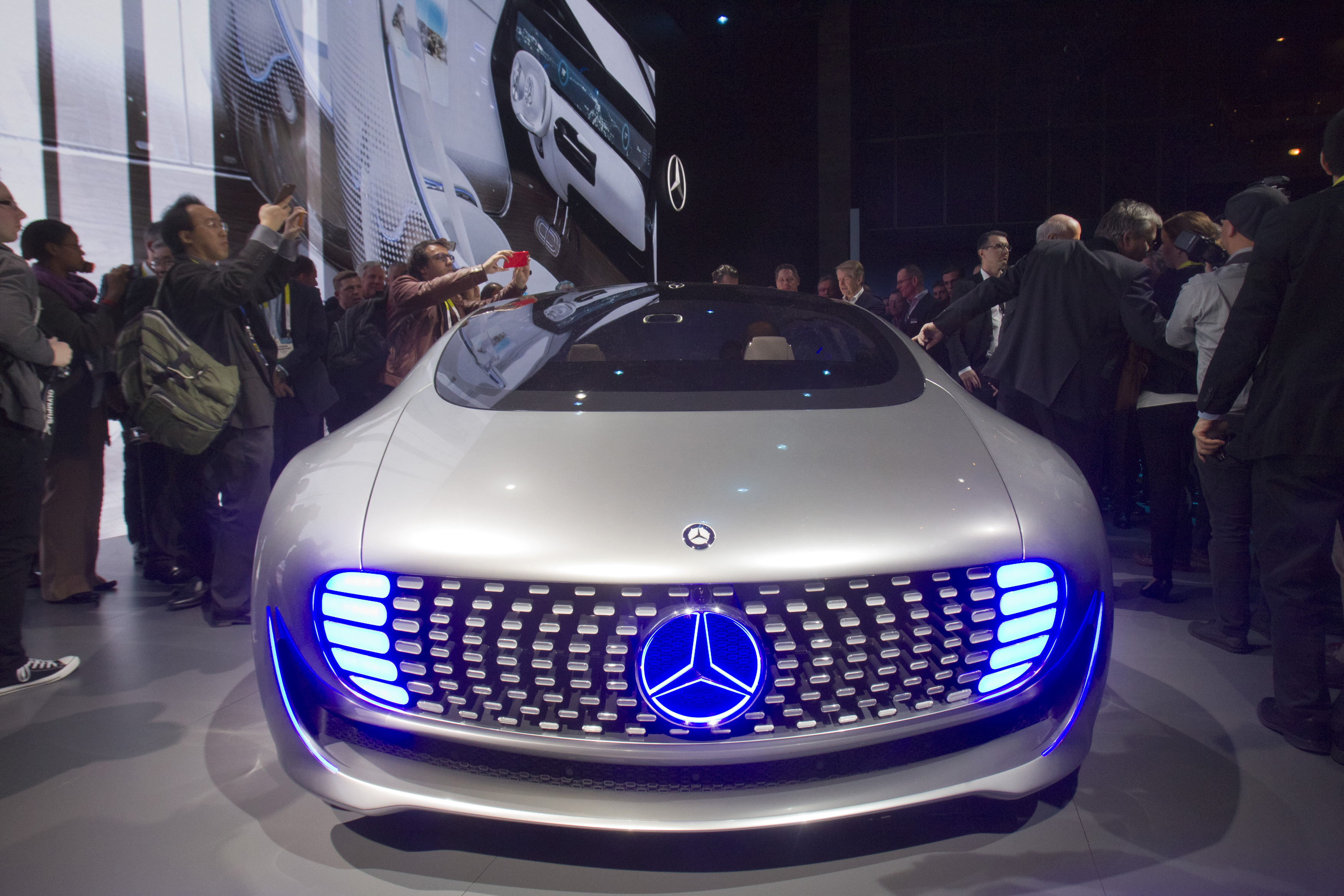 Journalist surround the Mercedes-Benz F015 Luxury in Motion autonomous concept car after it was unveiled during the 2015 International Consumer Electronics Show in Las Vegas