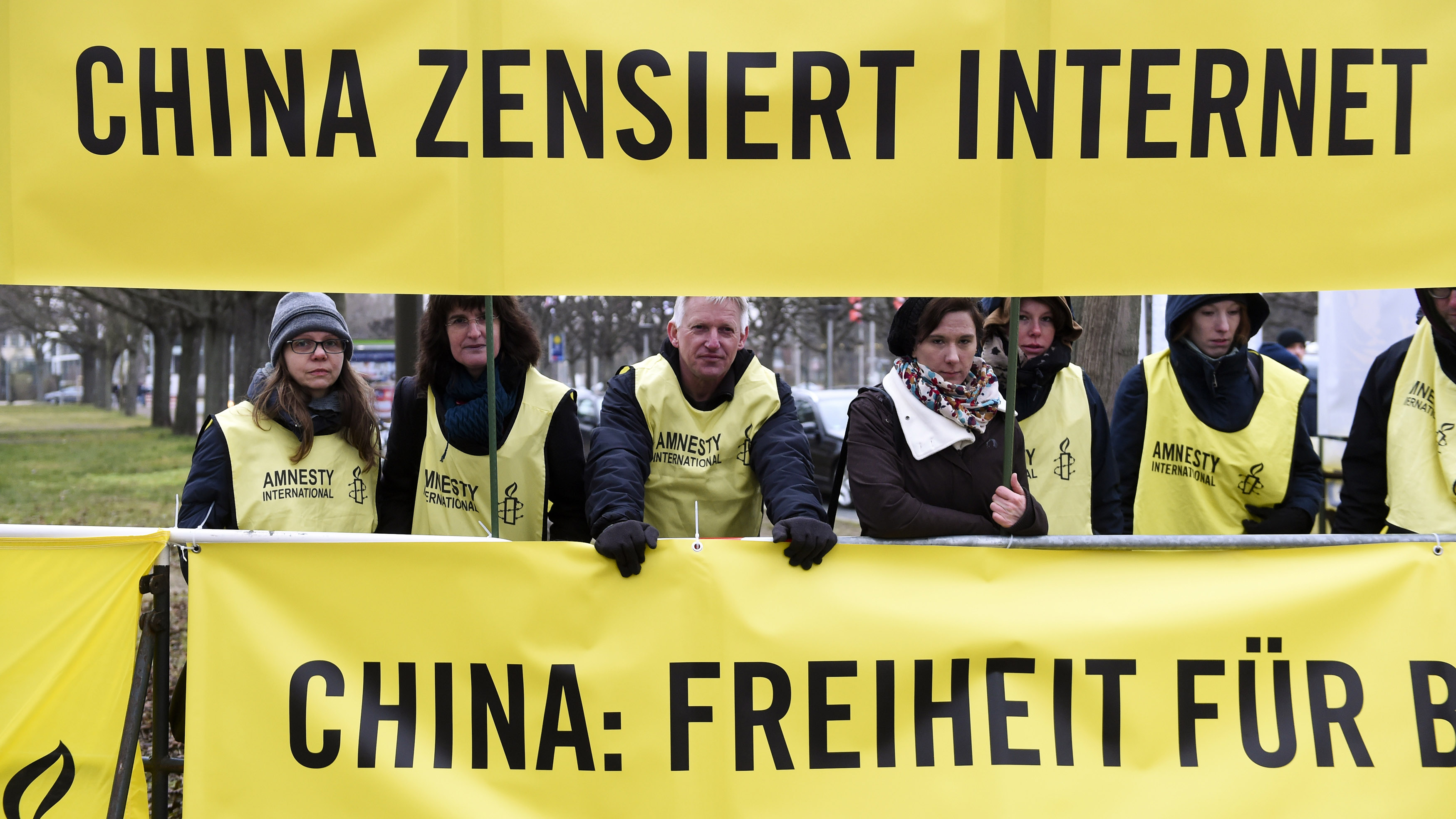 Members of Amnesty International hold a banner protesting internet censorship in China.