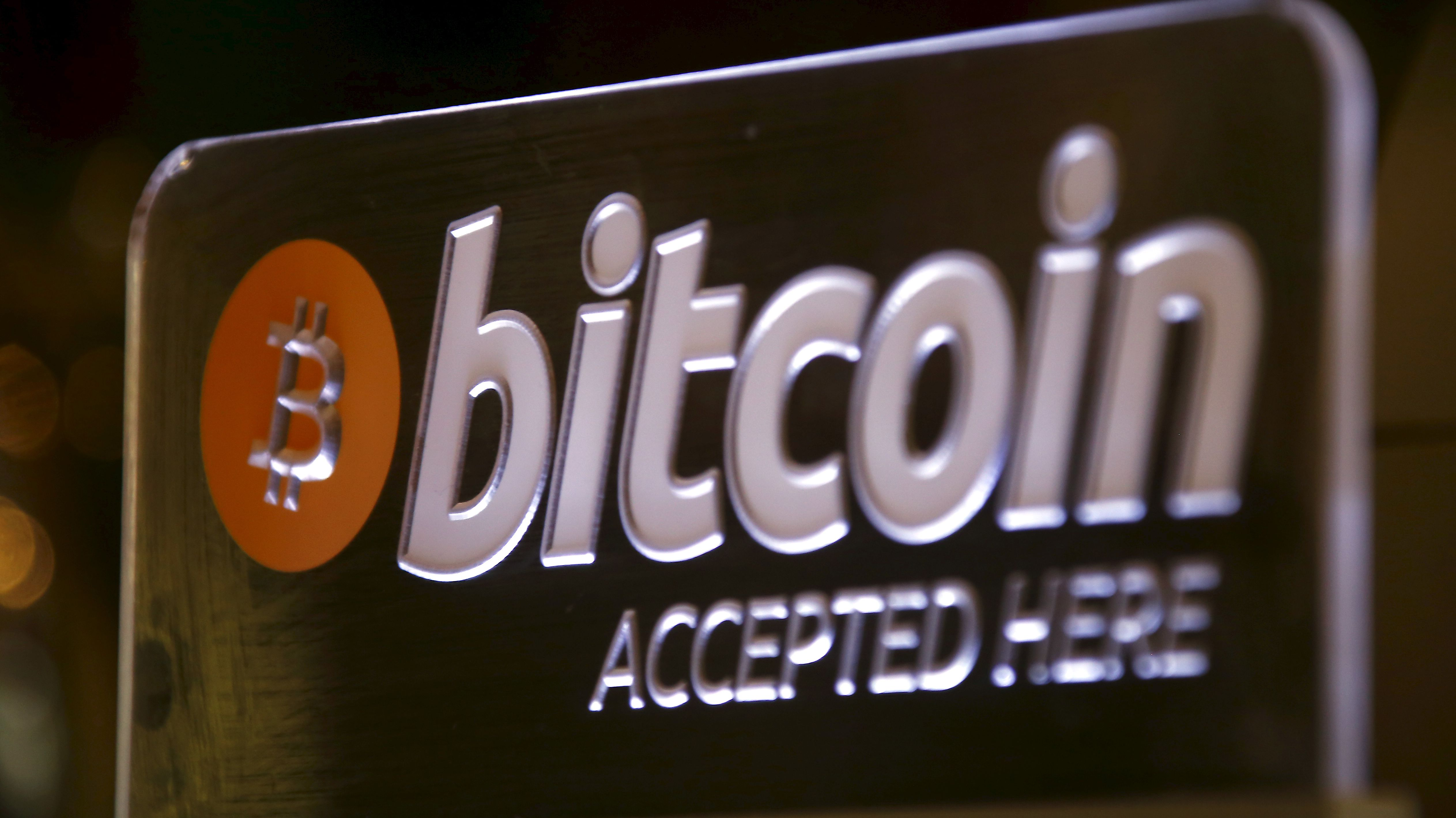 A Bitcoin sign can be seen on display at a bar in central Sydney, Australia, September 29, 2015. Australian businesses are turning their backs on bitcoin, as signs grow that the cryptocurrency's mainstream appeal is fading. Concerns about bitcoin's potential crime links mean many businesses have stopped accepting it, a trend accelerated by Australian banks' move last month to close the accounts of 13 of the country's 17 bitcoin exchanges. Picture taken September 29, 2015.