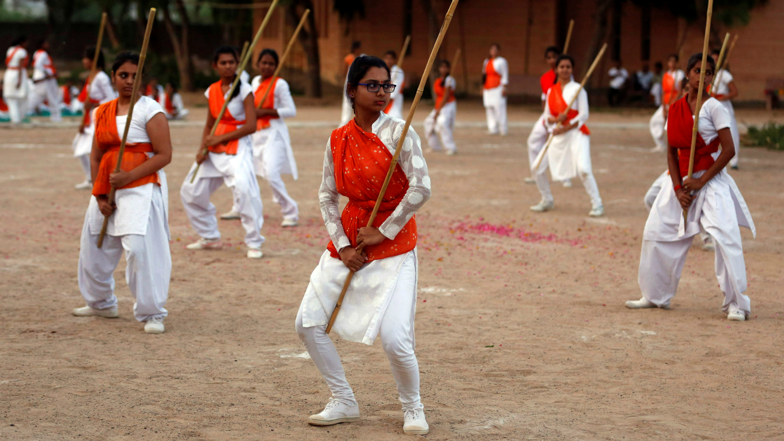 Members of Durga Vahini, the women's wing of hardline Vishwa Hindu Parishad, show their self-defence skills with sticks at the concluding ceremony of a weeklong women's training camp on the outskirts of Ahmedabad, India May 21, 2016.